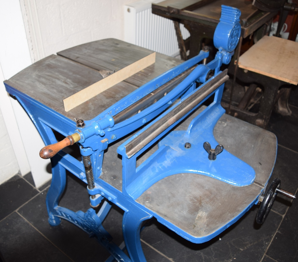 Lot 58 - *Board Cutter. Large heavy cast iron free standing board cutter by Harrild & Sons, finished in blue,