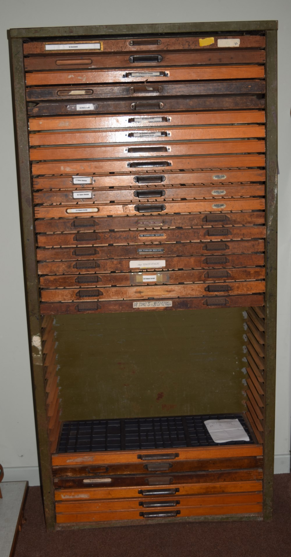 Lot 55 - *Type Cabinet. A large 36 drawer type cabinet, containing 25 varying printer's type tray draws only,