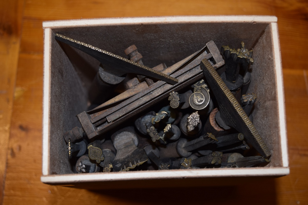 Lot 32 - *Decorative finishing tools. A collection of twenty-five brass decorative finishing tools,