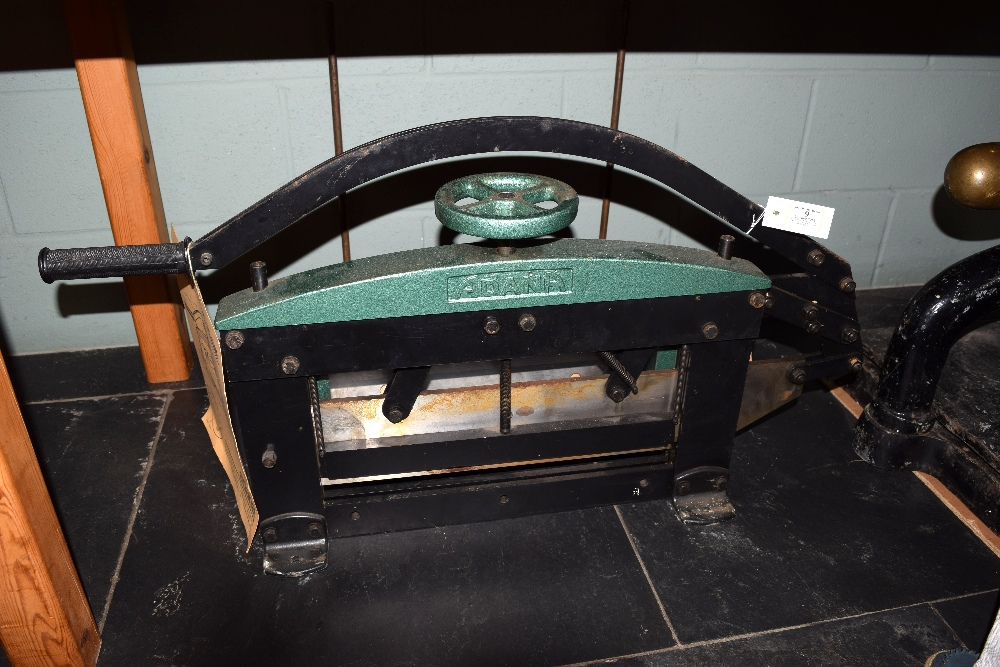 """Lot 9 - *Guillotine. An Adana 17"""" (432mm) Guillotine, finished in metallic green, with attachable cutting"""