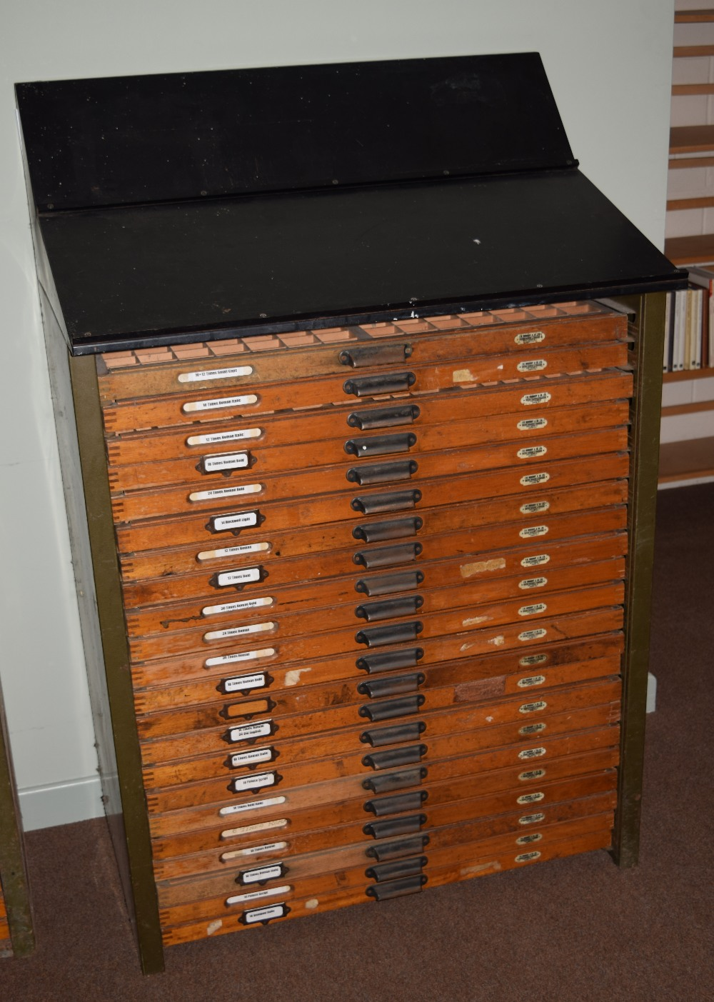 Lot 56 - *Type Cabinet. A large 22 drawer type cabinet by F.W. Woodroff & Co. Ltd., with compositor's slope