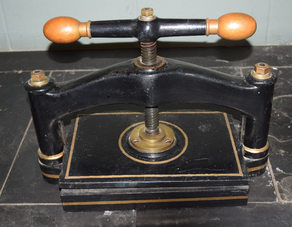 Lot 3 - *Bookpress. A cast iron bookpress, with brass handles, platen size approximately 38 x 35cm (15 x