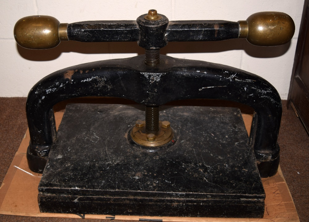 Lot 1 - *Bookpress. A large cast iron bookpress, finished in black, with brass handle ends, platen