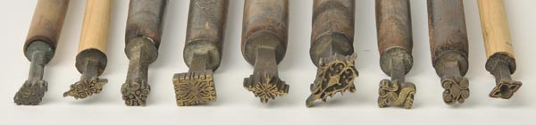 Lot 35 - *Decorative finishing tools. A collection of twenty-seven brass decorative finishing tools, majority