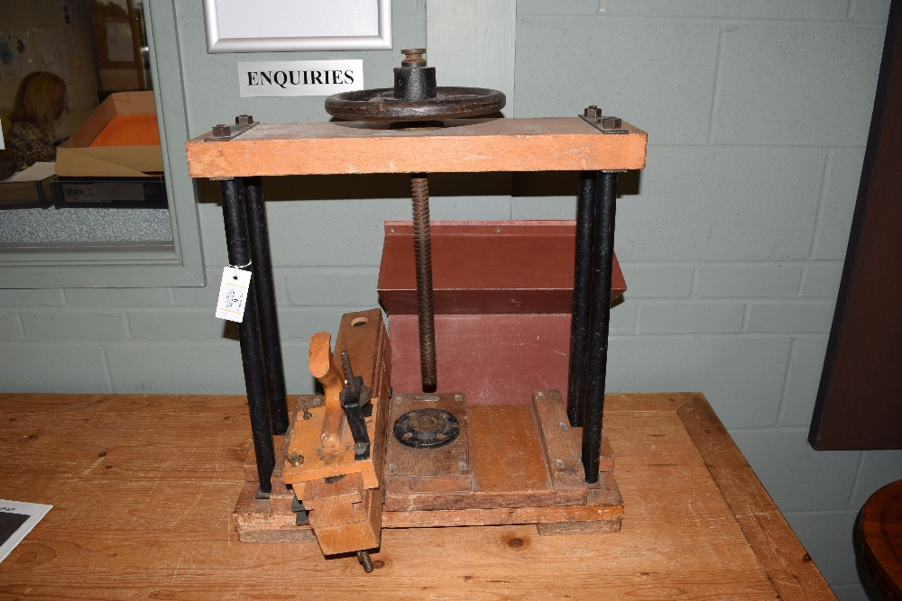 Lot 6 - *Bookpress. A Dryad Bookpress, with wooden platen and metal column side supports, central screw