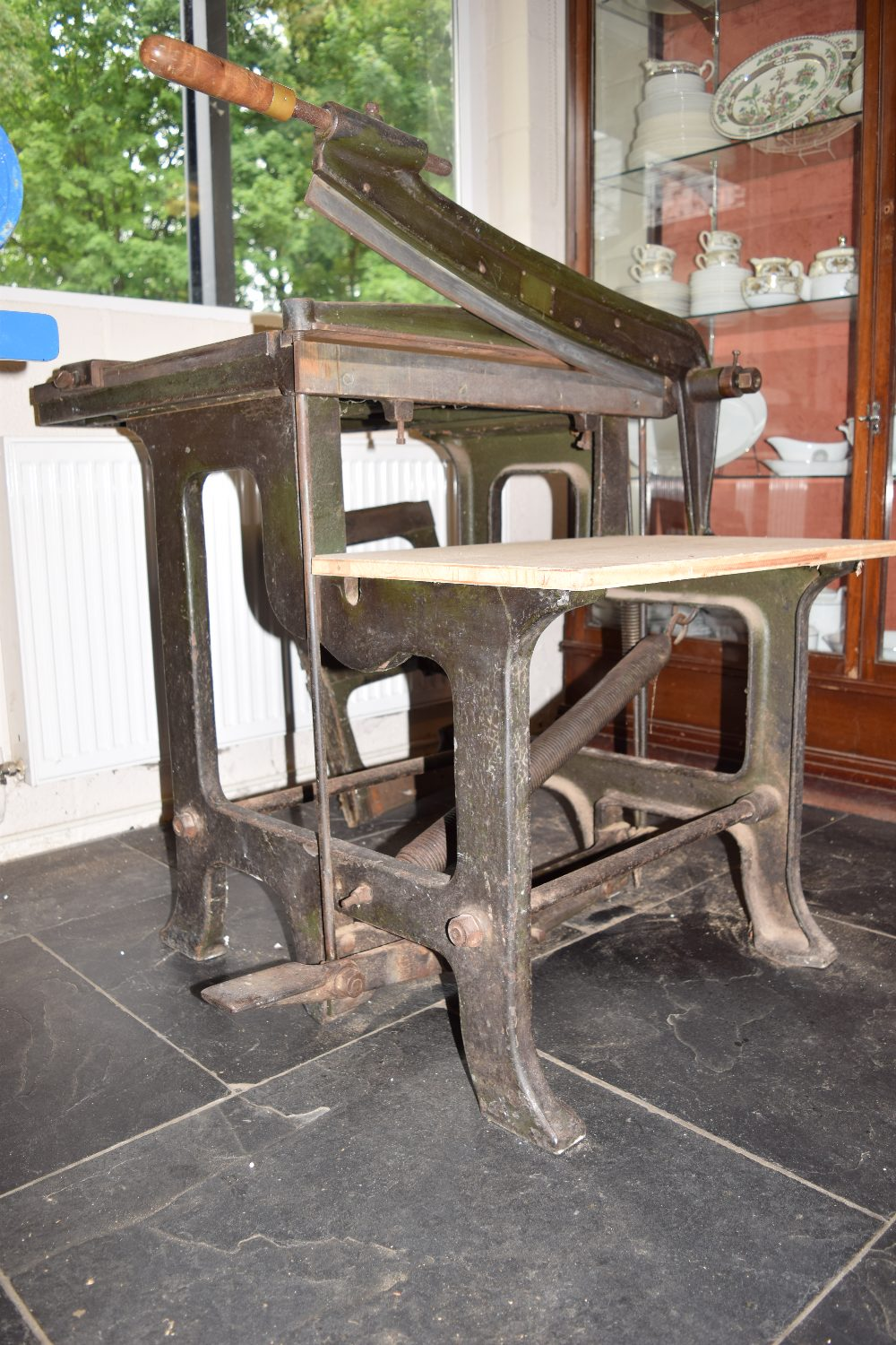 Lot 5 - *Board Cutter. Large heavy cast iron free standing board cutter finished in black, sprung blade