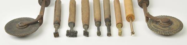 Lot 19 - *Decorative finishing tools. Thirty-seven brass decorative finishing tools, mostly of traditional