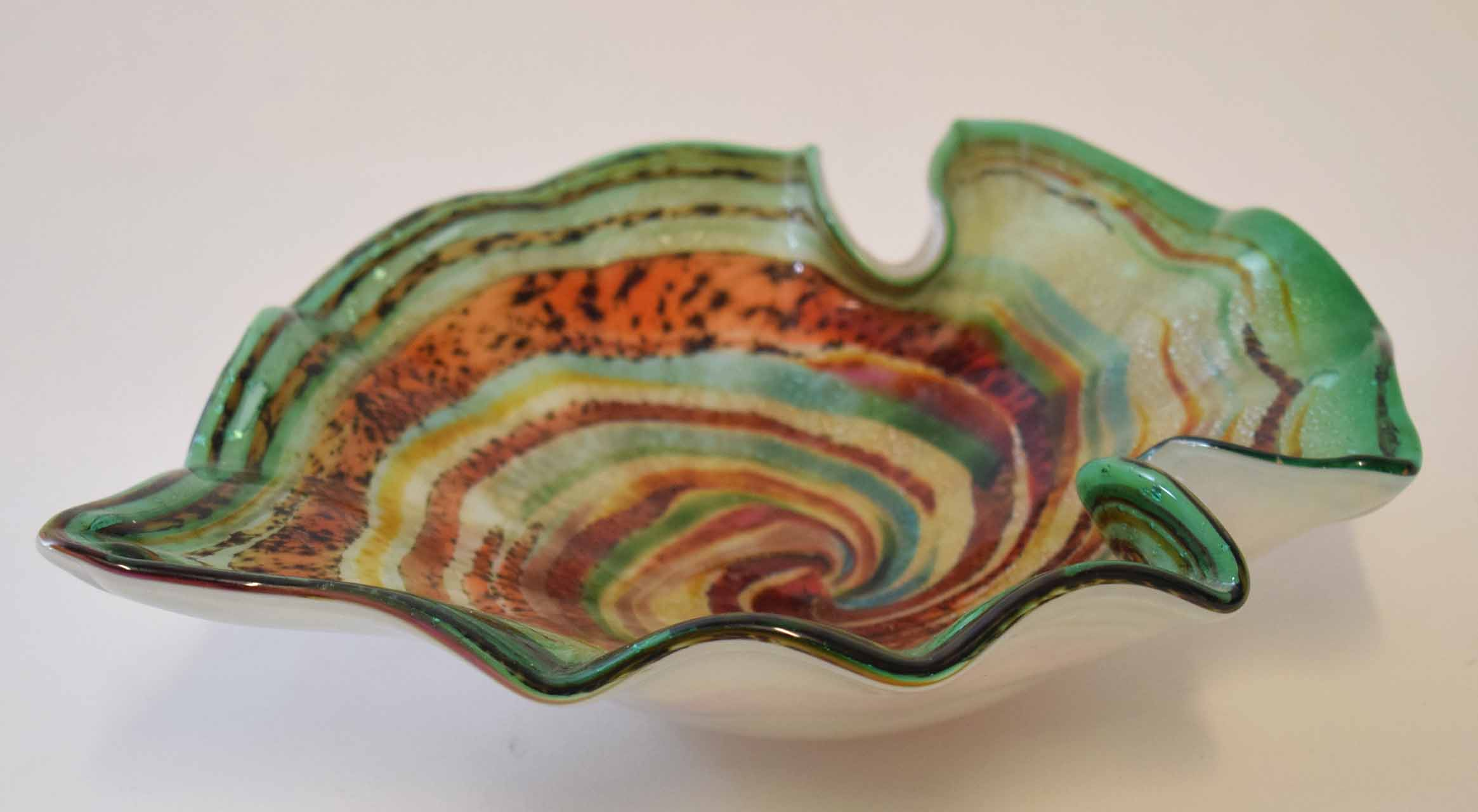 Lot 73 - Art glass bowl with swirling green and brown design, 17cm diam