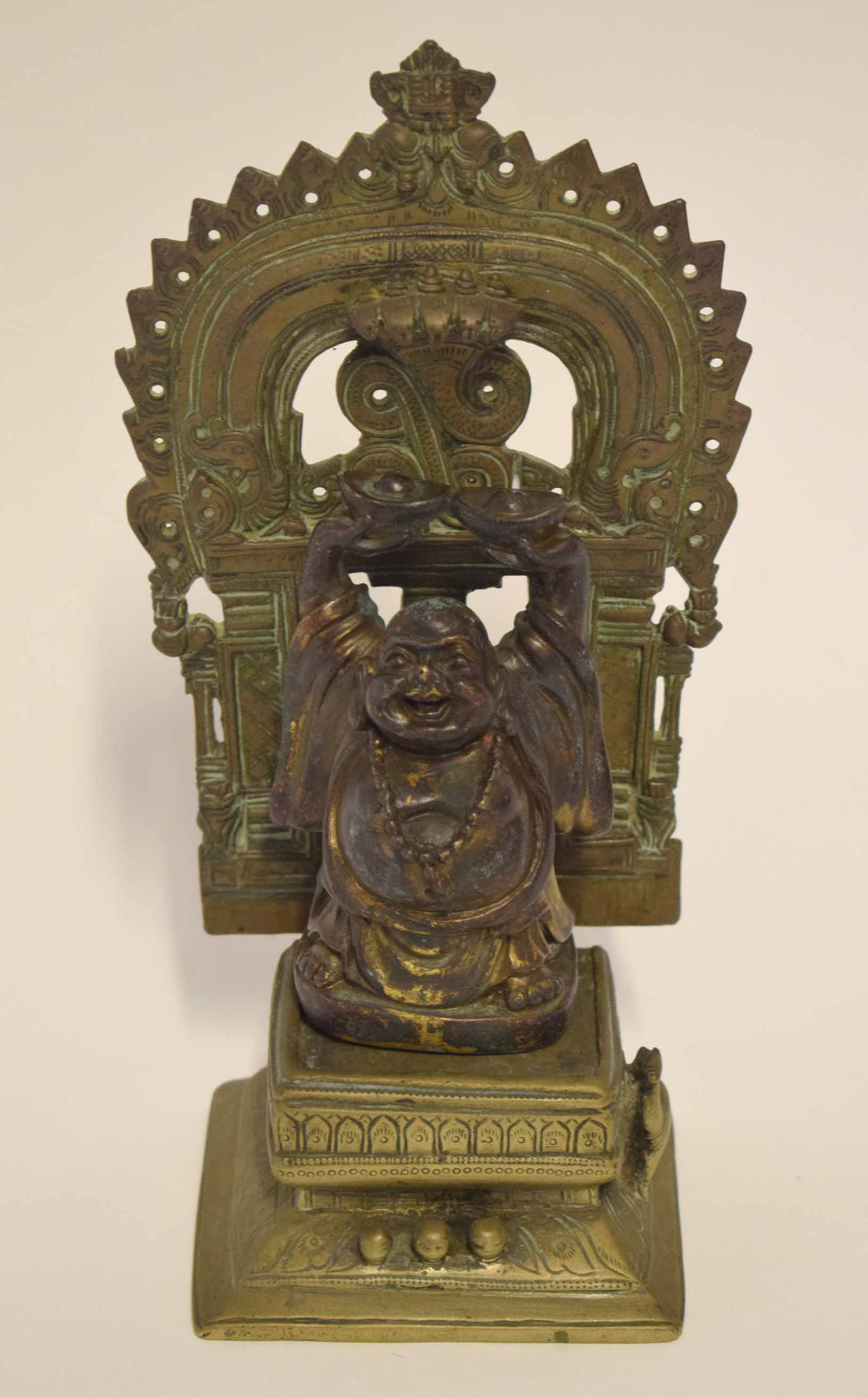 Lot 25 - Bronzed metal figure of Buddha on a separate base, Middle Eastern in style, with a detachable