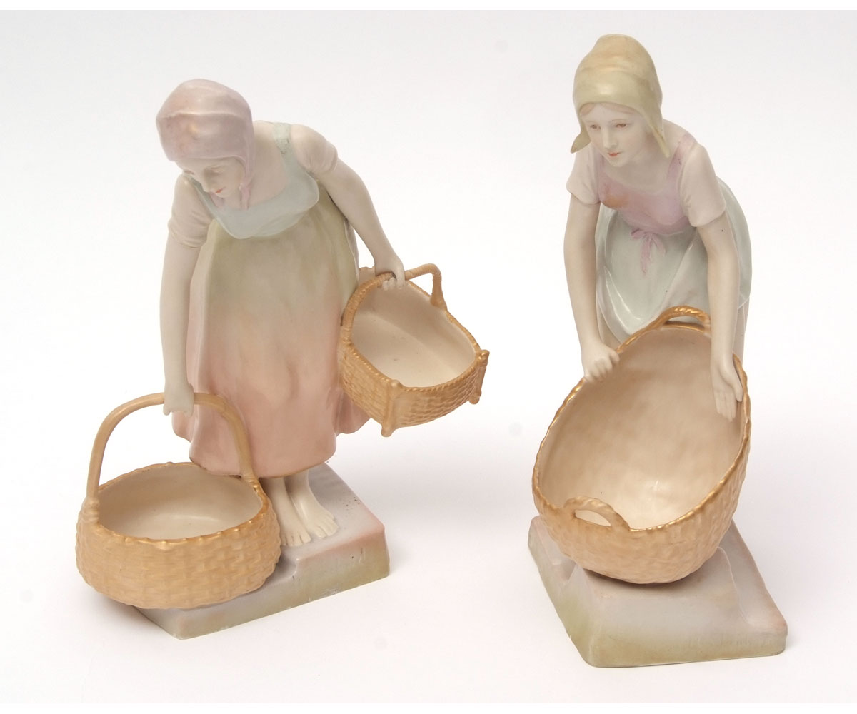 Lot 115 - Pair of Austrian Turn pottery figures modelled as girls carrying baskets on a stepped base, the