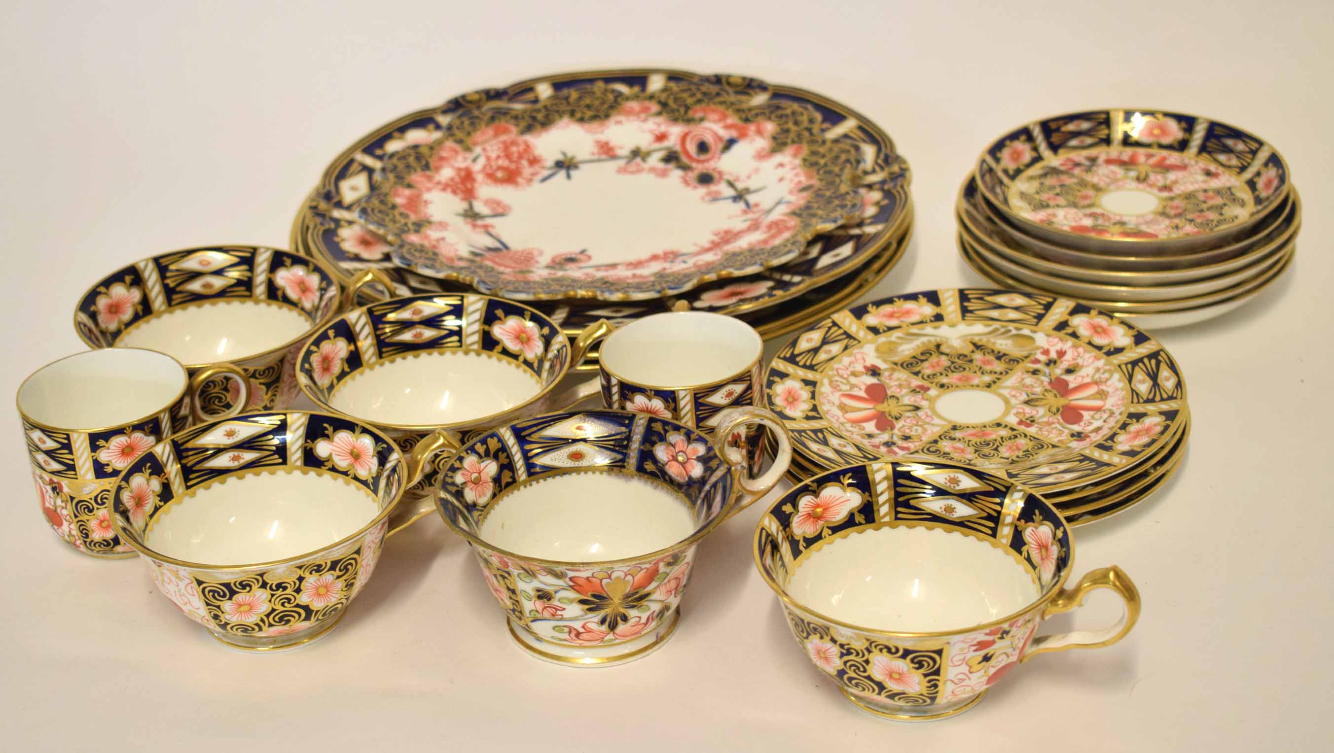 Lot 118 - Collection of Royal Crown Derby wares in Imari style comprising three large plates, a plate with