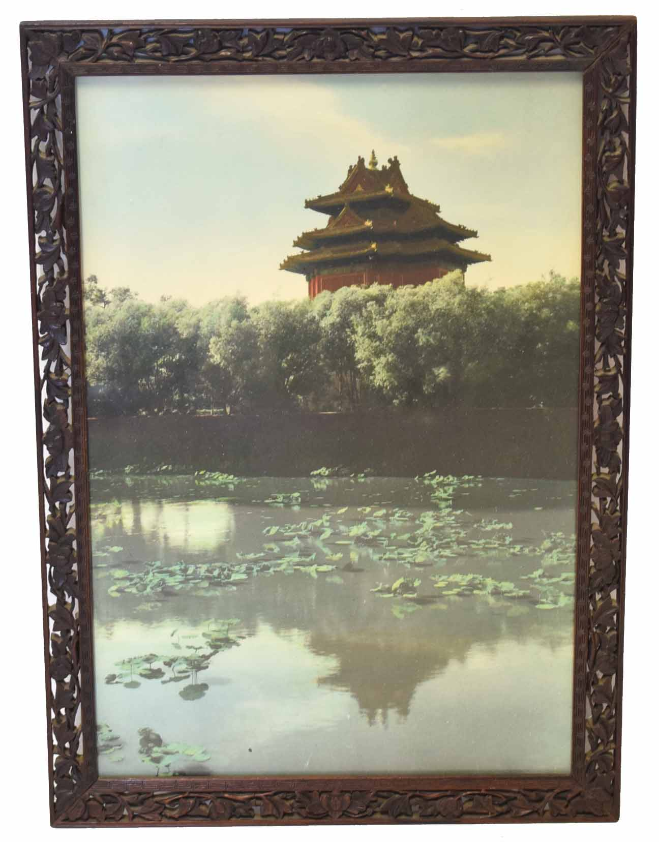 Lot 50 - Oriental print of a temple in carved wooden frame
