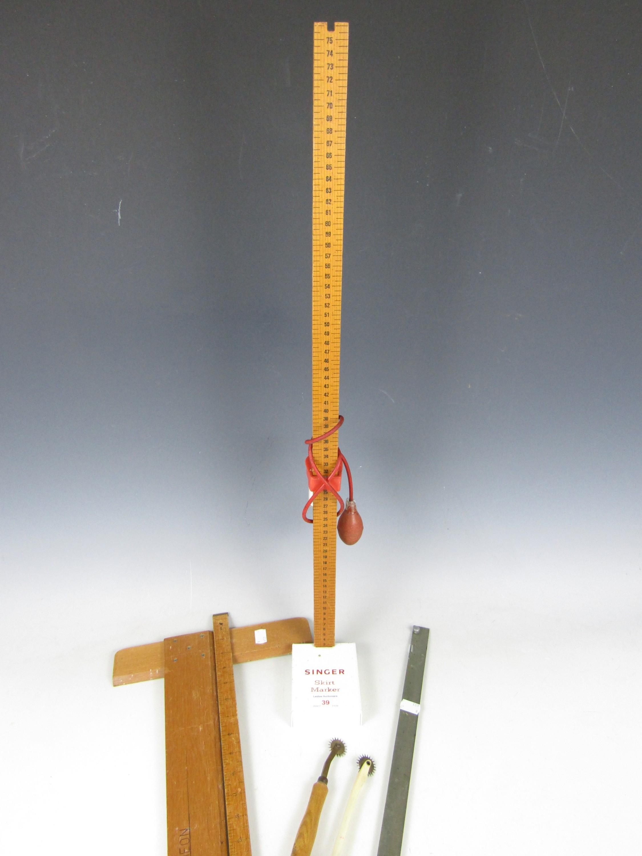 Lot 39 - A vintage dress-makers' Singer skirt hem marker together with a tailors' rule etc