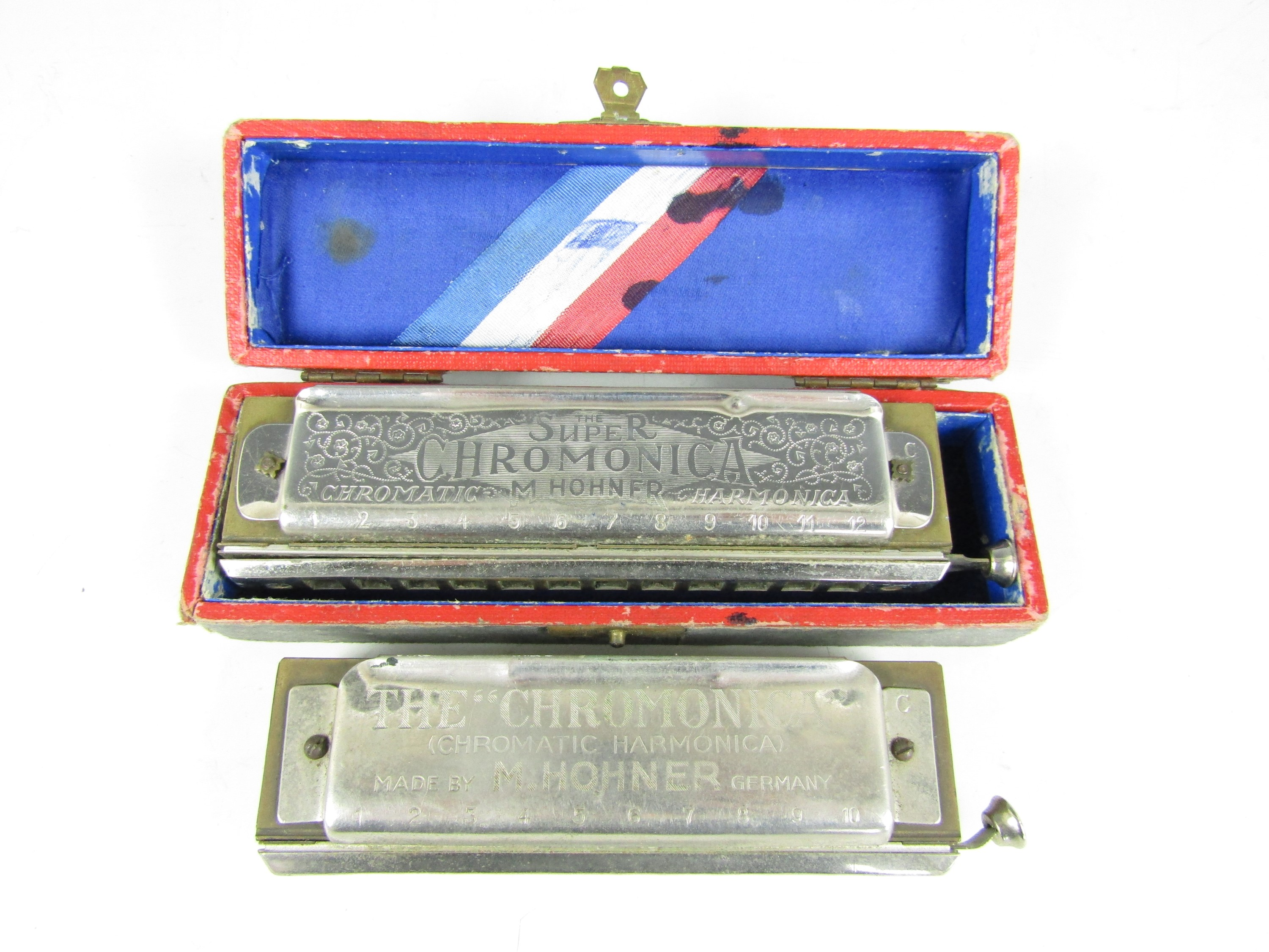 Lot 37 - A boxed Hohner The Super Chromonica chromatic harmonica together with one other