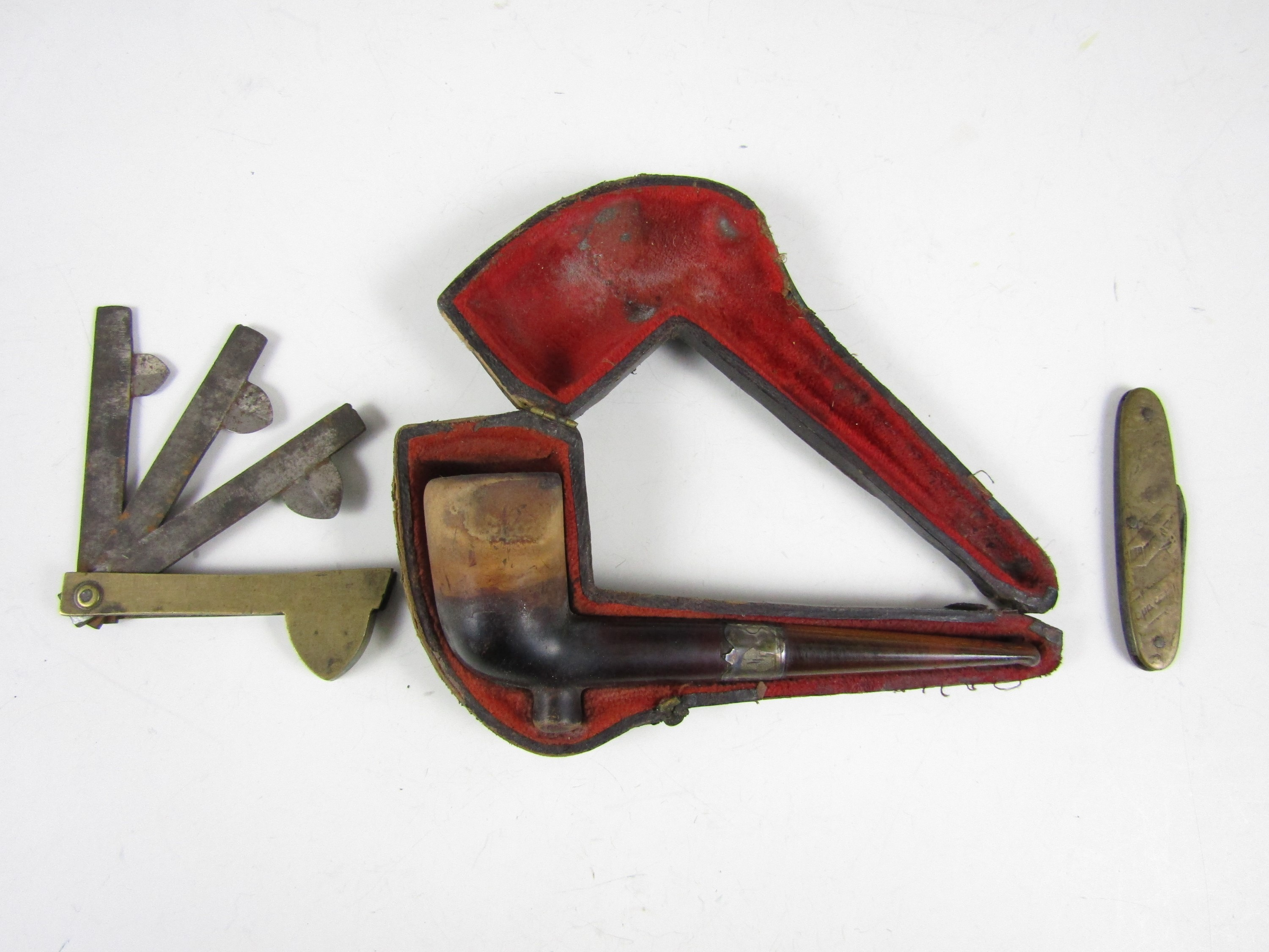 Lot 8 - A Victorian cased meerschaum pipe together with a novelty aviation themed pen knife and a 19th