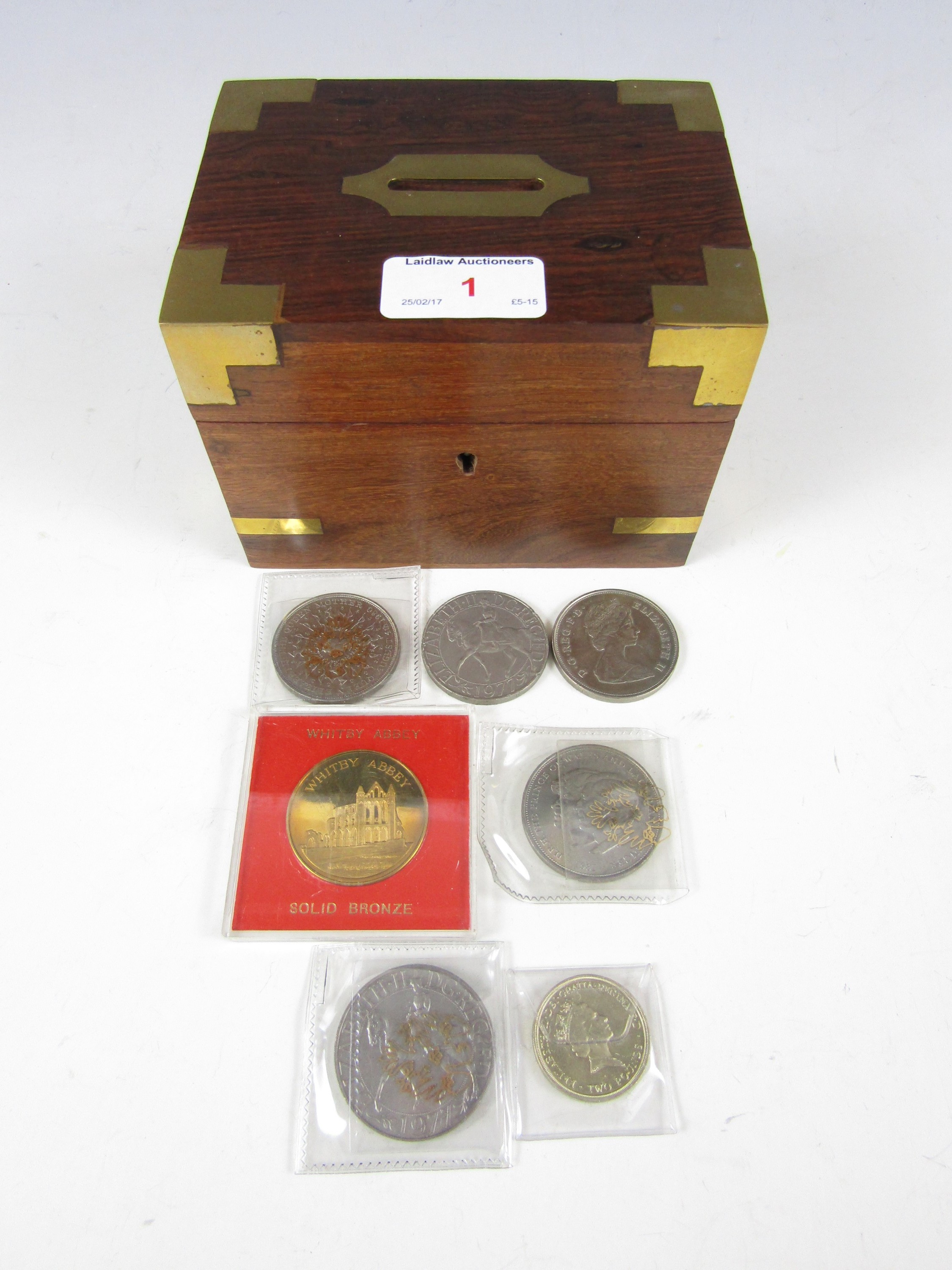 Lot 1 - A brass-mounted money box containing a small quantity of coins