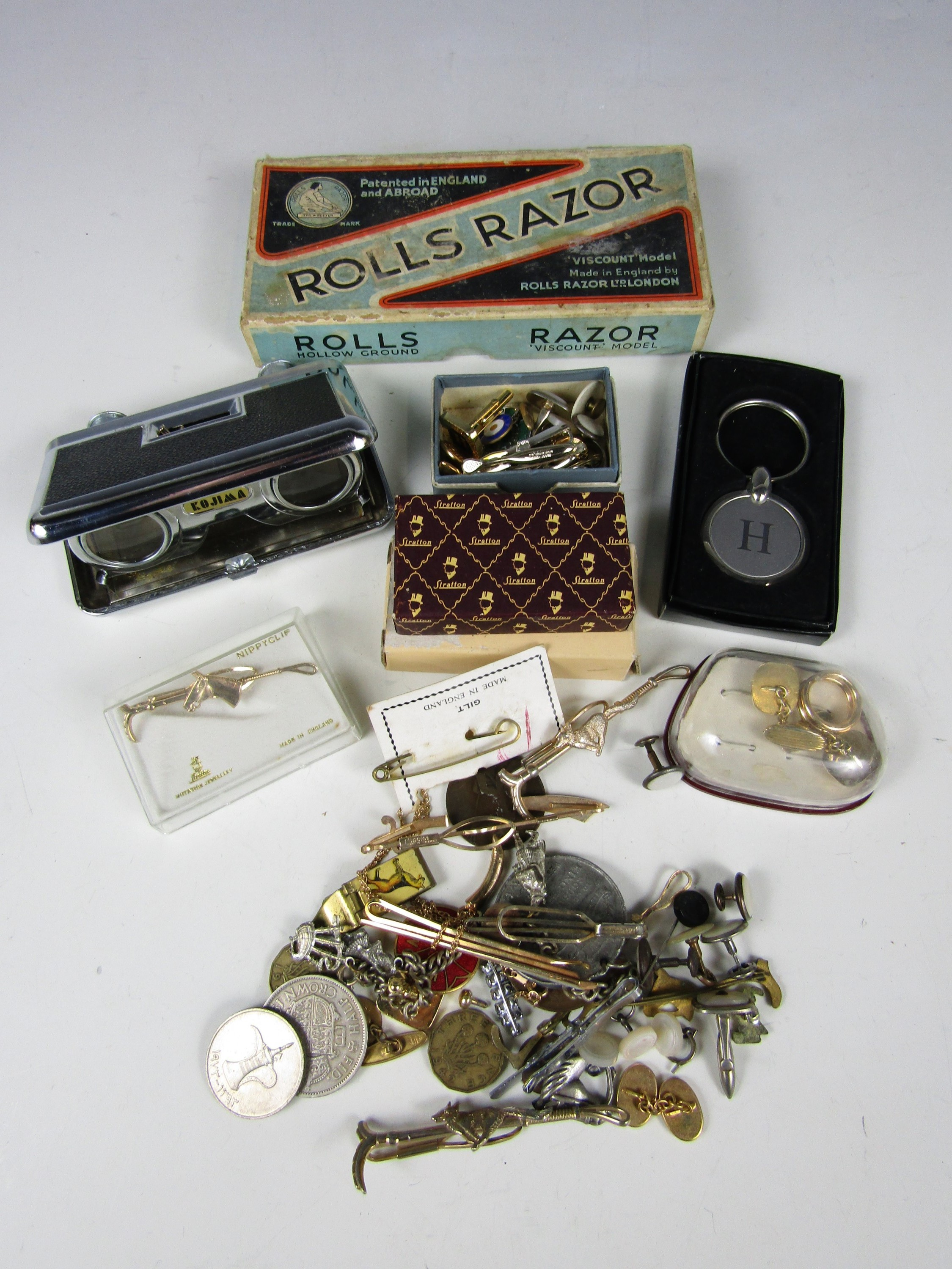 Lot 9 - Opera / field glasses together with a Rolls Razor, a lighter, cuff links and tie pins etc