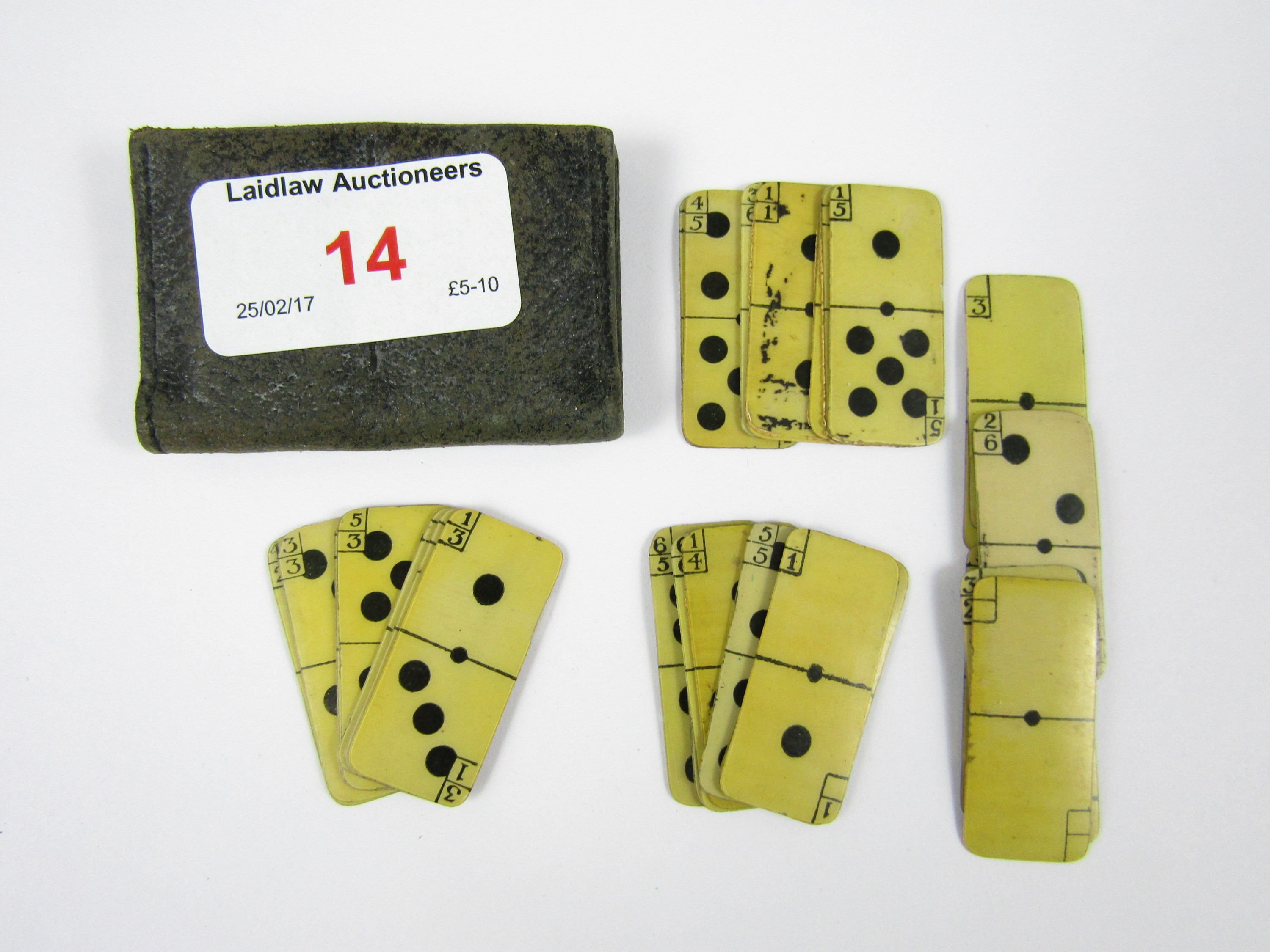 Lot 14 - A set of early 20th Century miniature ivorine dominoes in leather wallet
