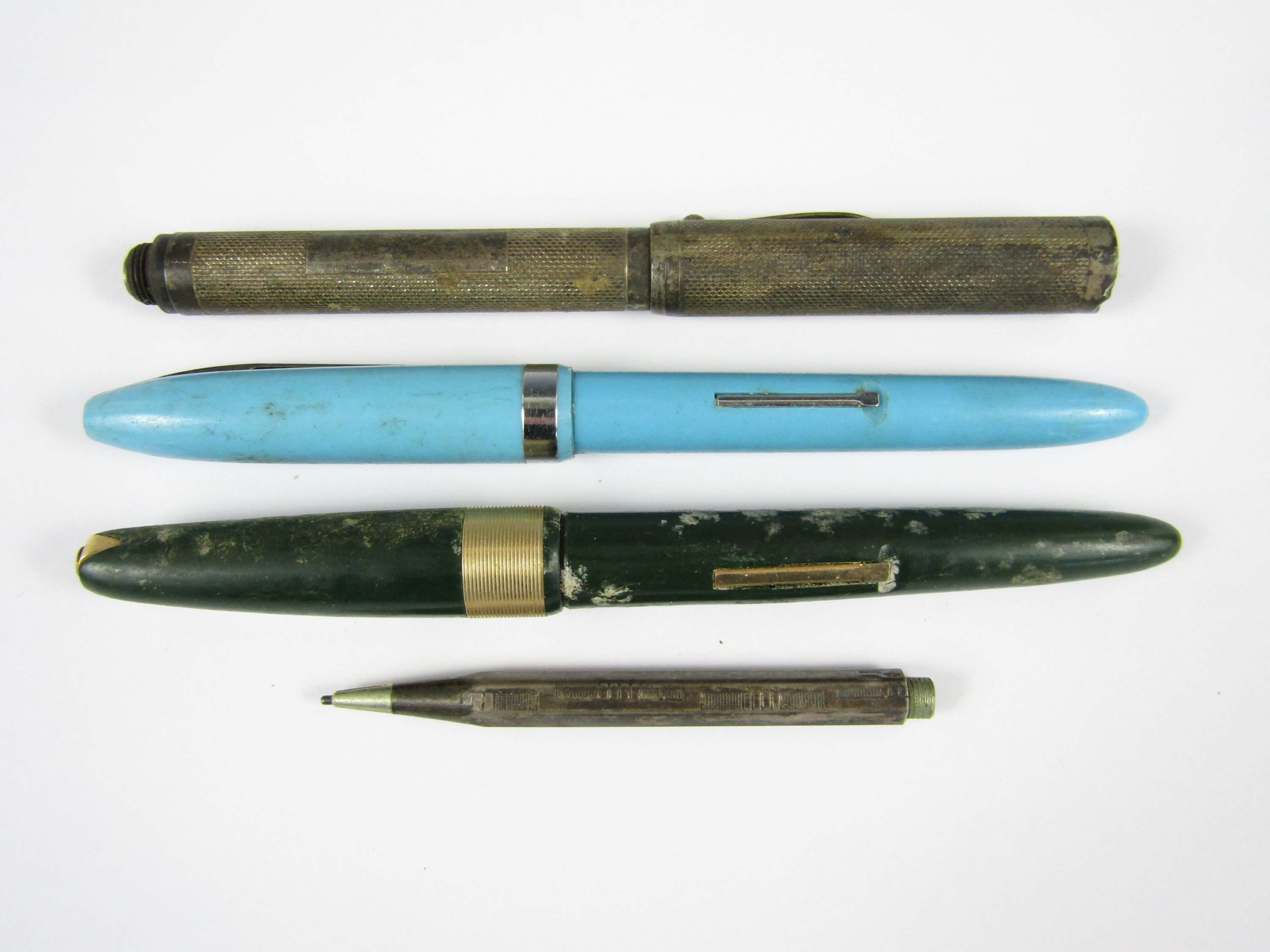 Lot 17 - A George V silver pen (a/f), together with a silver propelling pencil and two further vintage pens