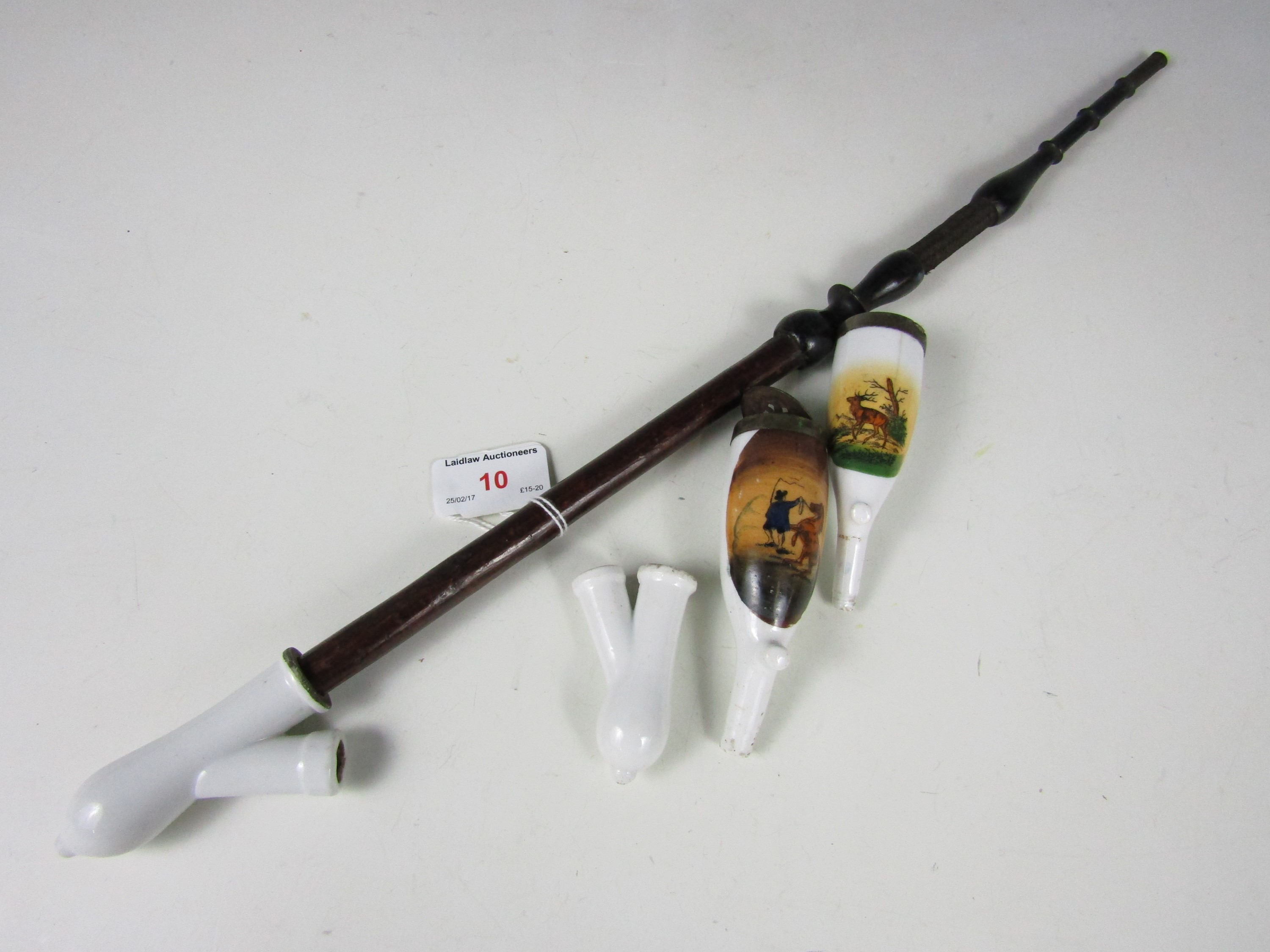 Lot 10 - A German pipe together with a pipe bowl