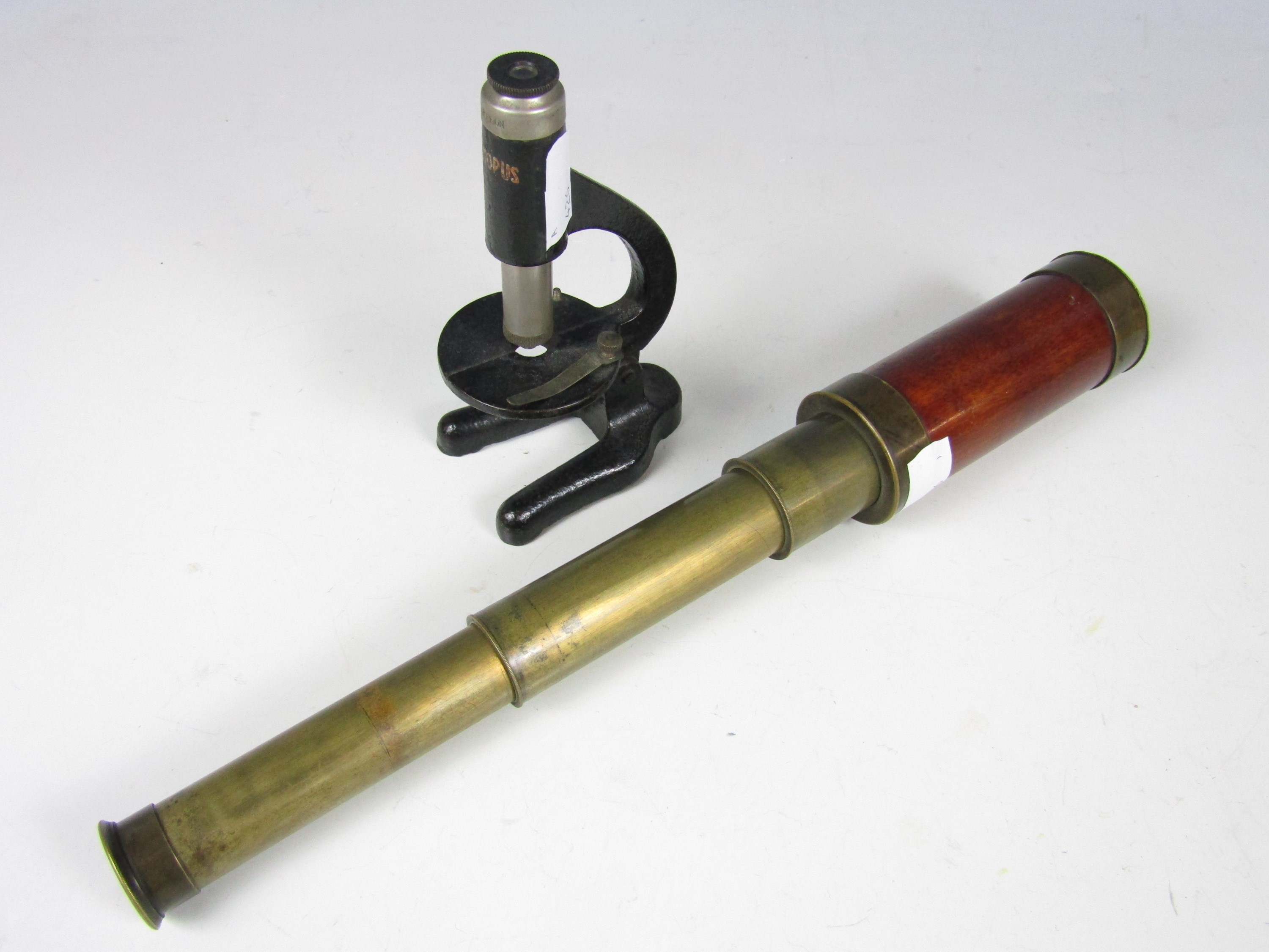 Lot 59 - A Victorian brass telescope together with a vintage Octopus toy microscope