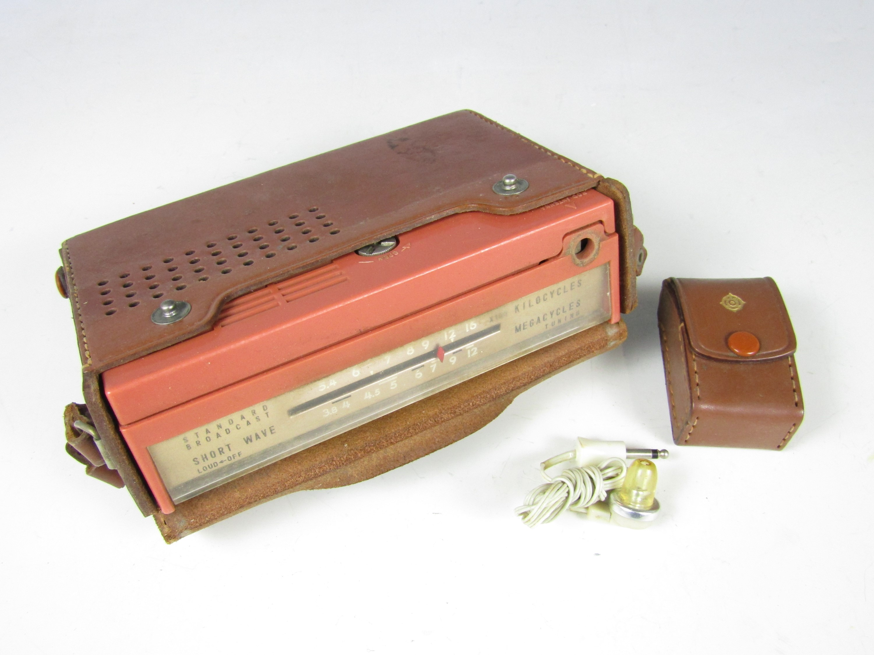 Lot 33 - A 1950's Hitachi WH-822 portable transistor radio and earphone