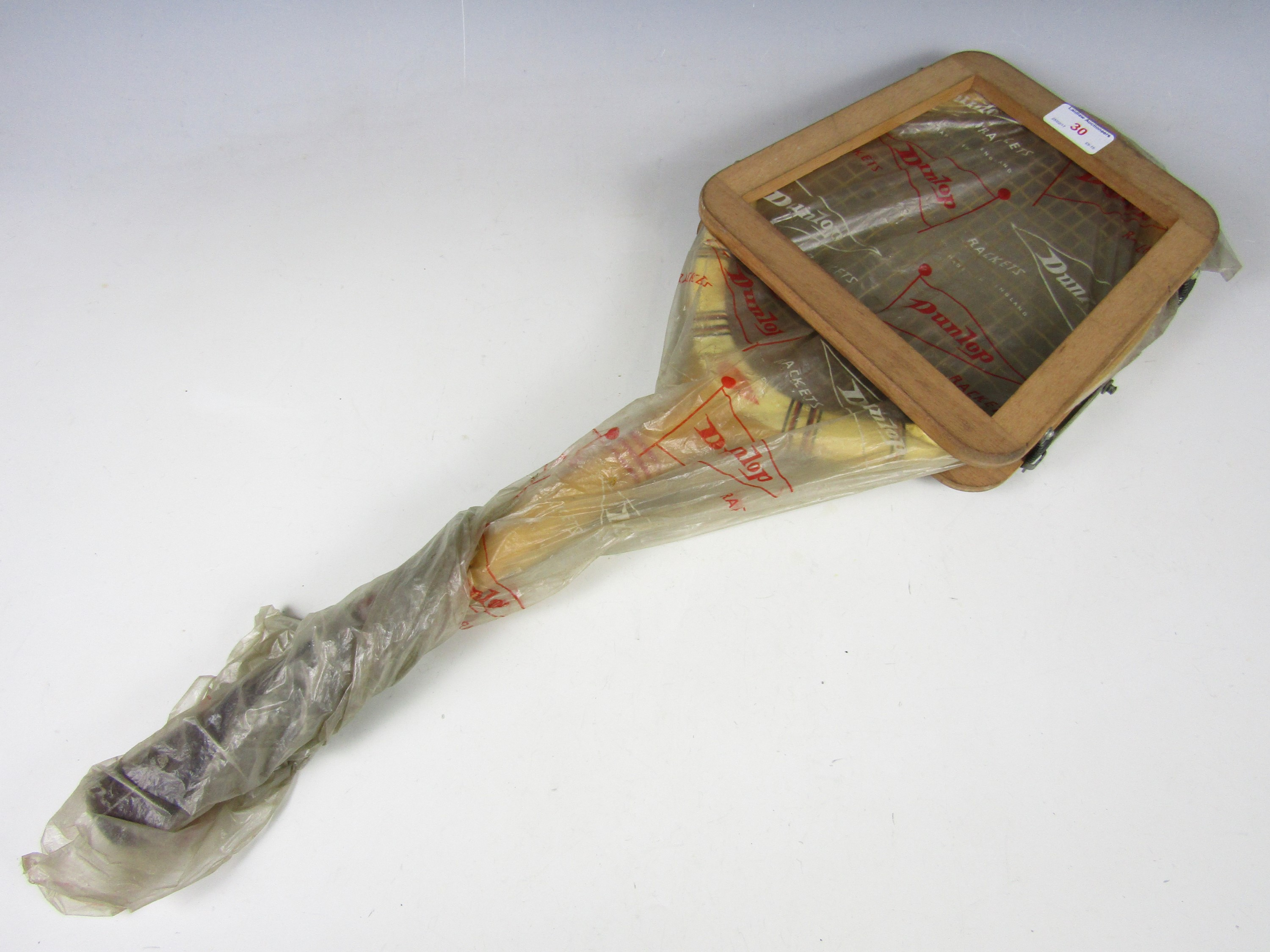 Lot 30 - A 1950's Dunlop Maxply tennis racket with original keeper and packaging