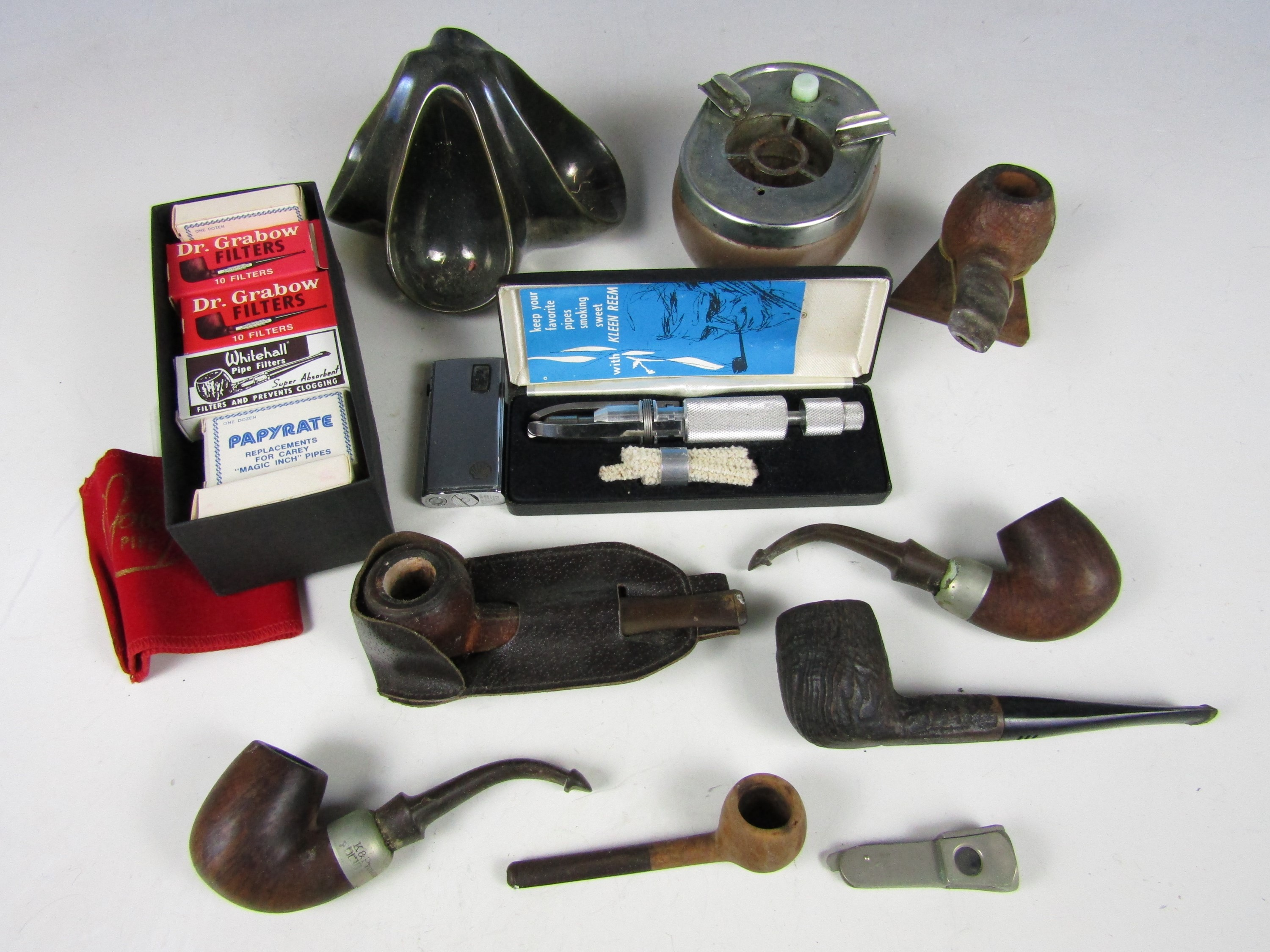 Lot 52 - Various pipes together with a pipe rack and a lighter etc