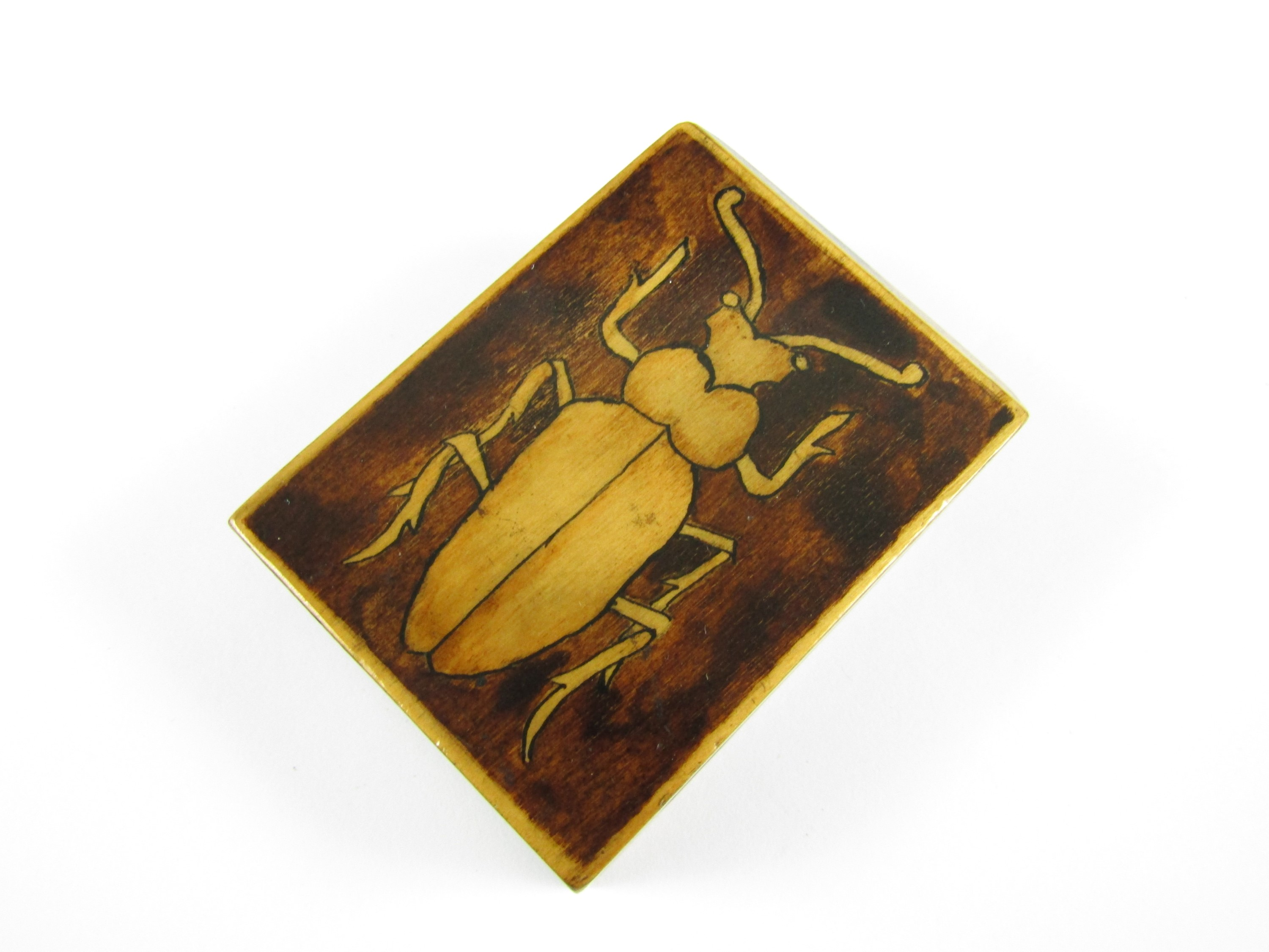 Lot 23 - A 1920's pen-work treen matchbox cover