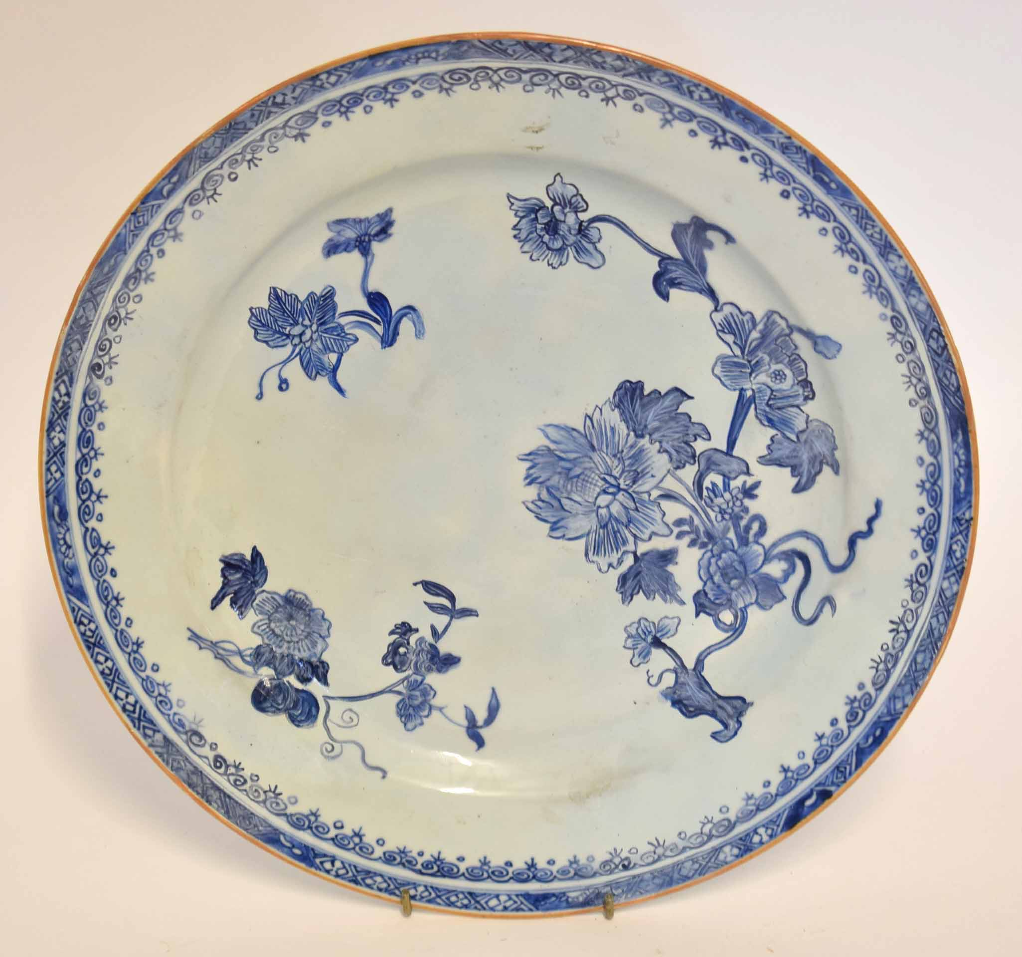 Lot 34 - 18th century Chinese charger with floral decoration in underglaze blue within a cell diaper border