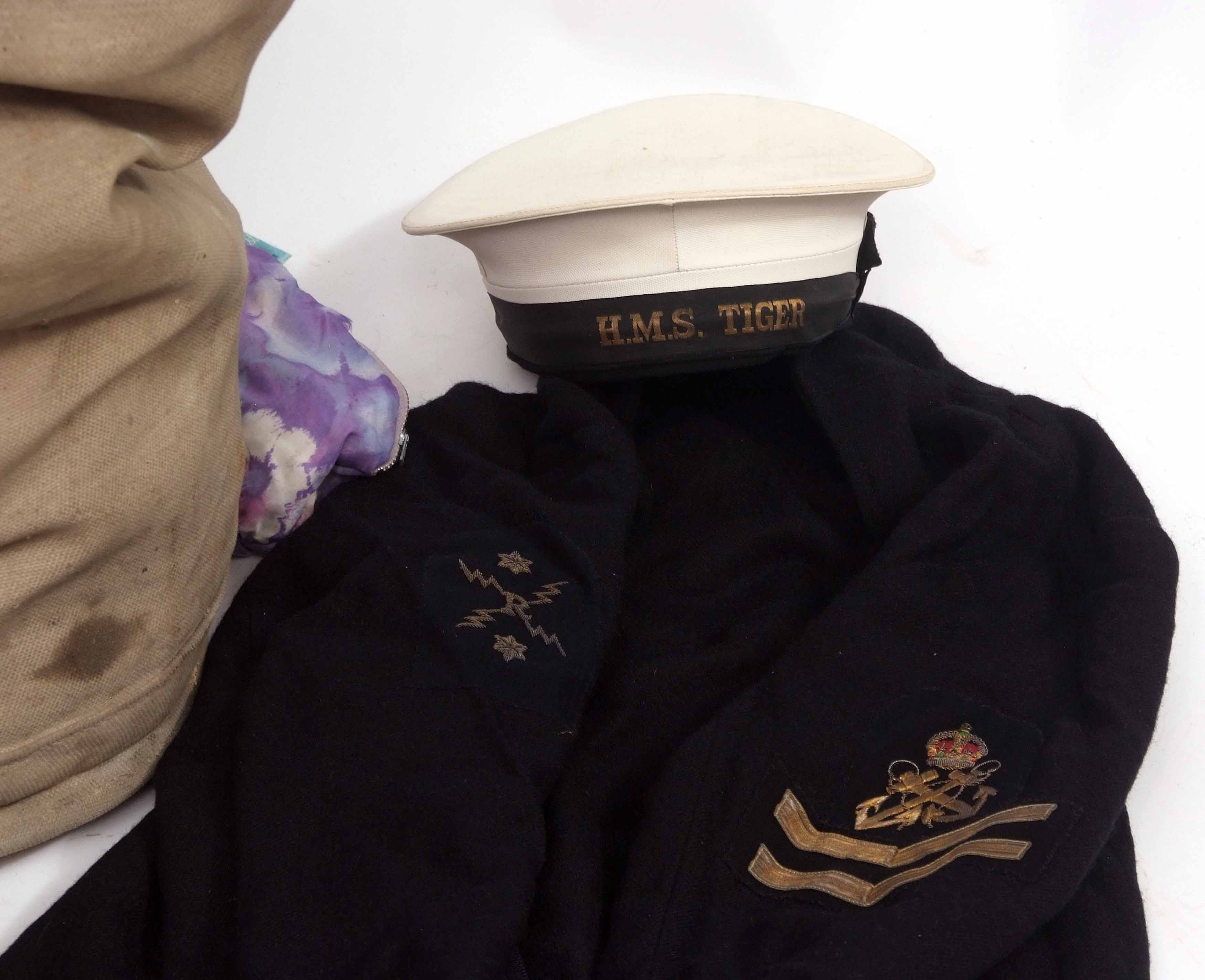 Lot 586 - Mid-20th century Royal Naval kitbag and contents comprising a white Naval cap with band to HMS Tiger