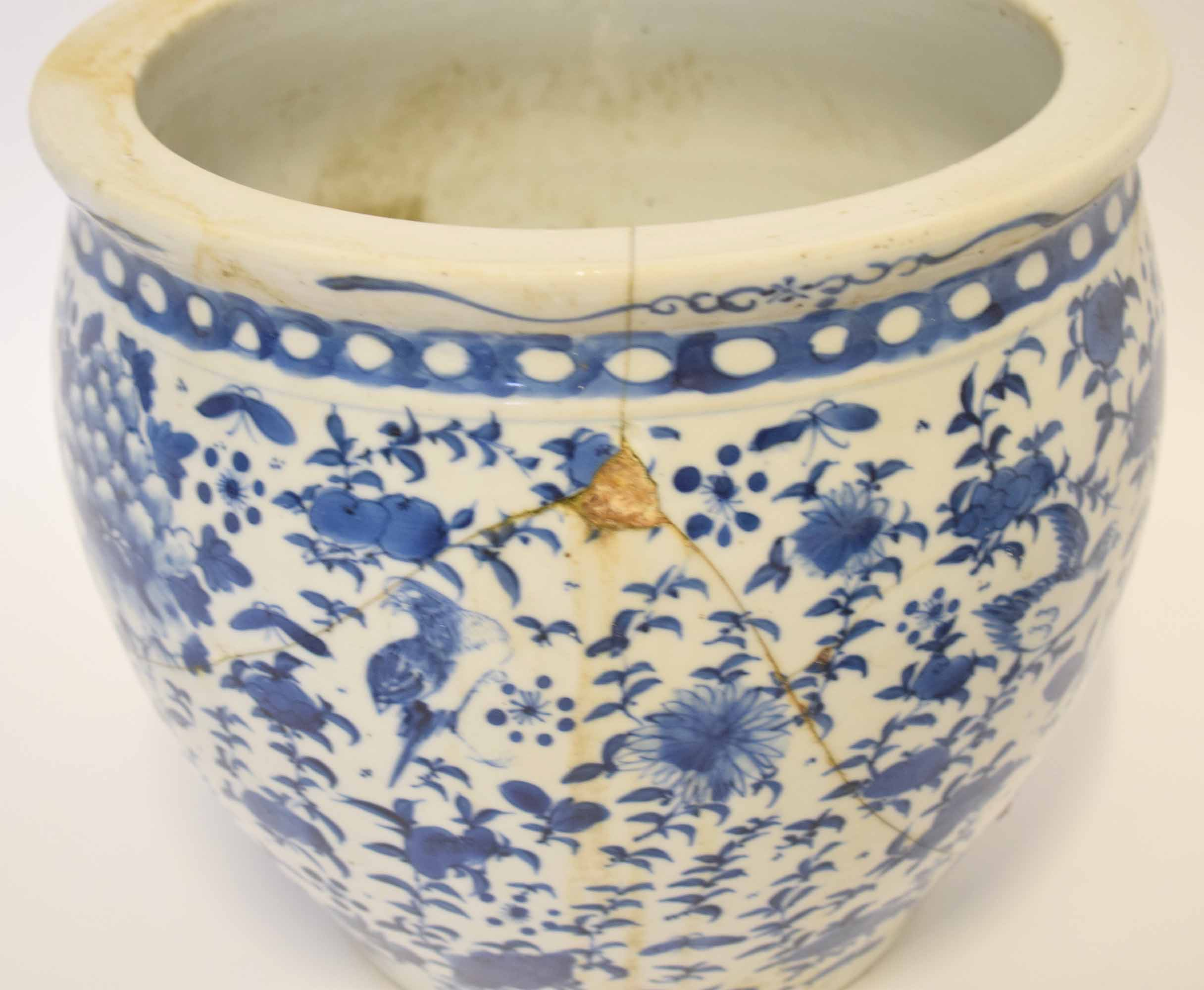 Lot 24 - Chinese porcelain large dish with blue and white design of birds amongst foliage and rock work