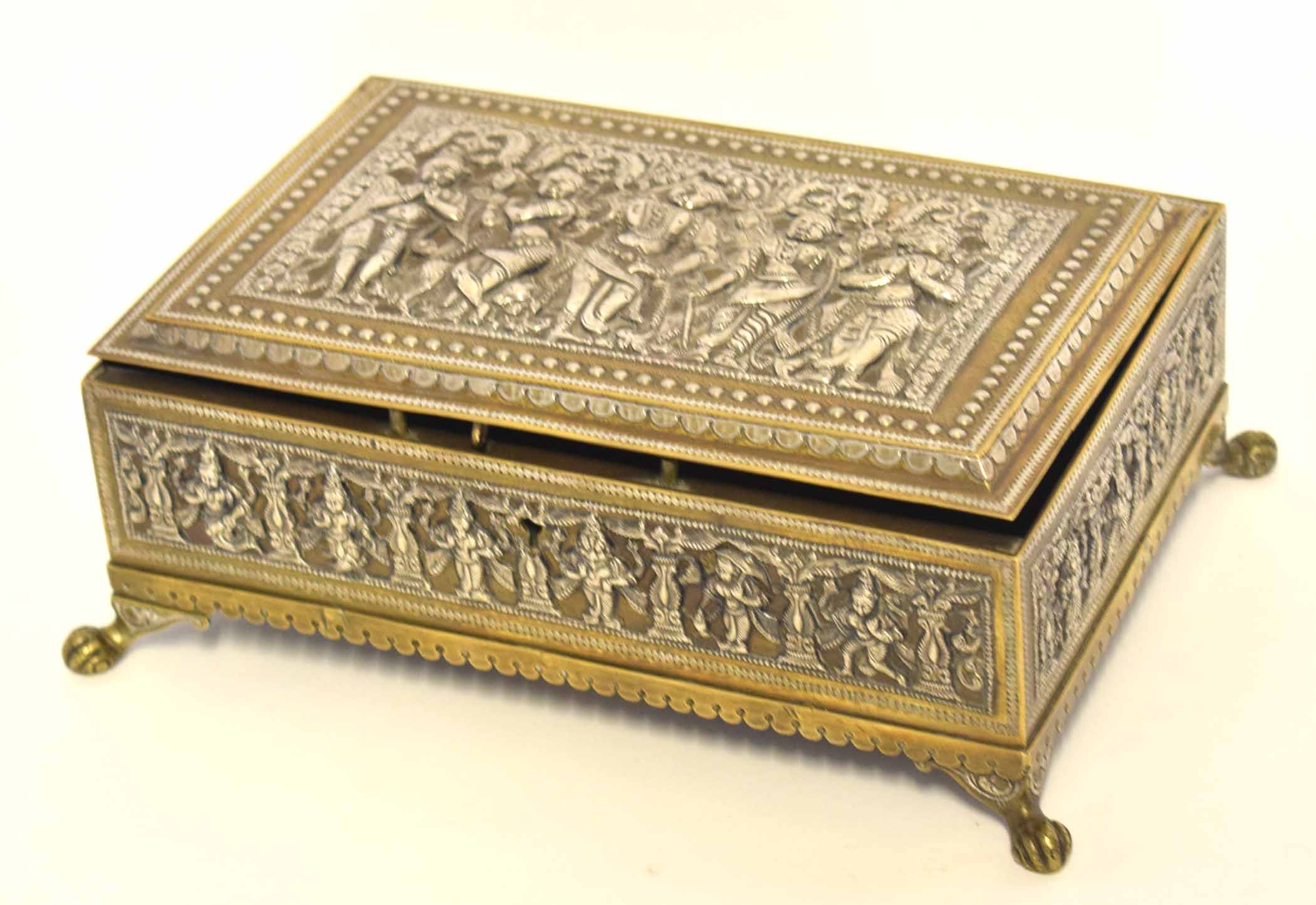 Lot 27 - Indian white metal casket on four paw feet with various Hindu deities modelled in relief to the