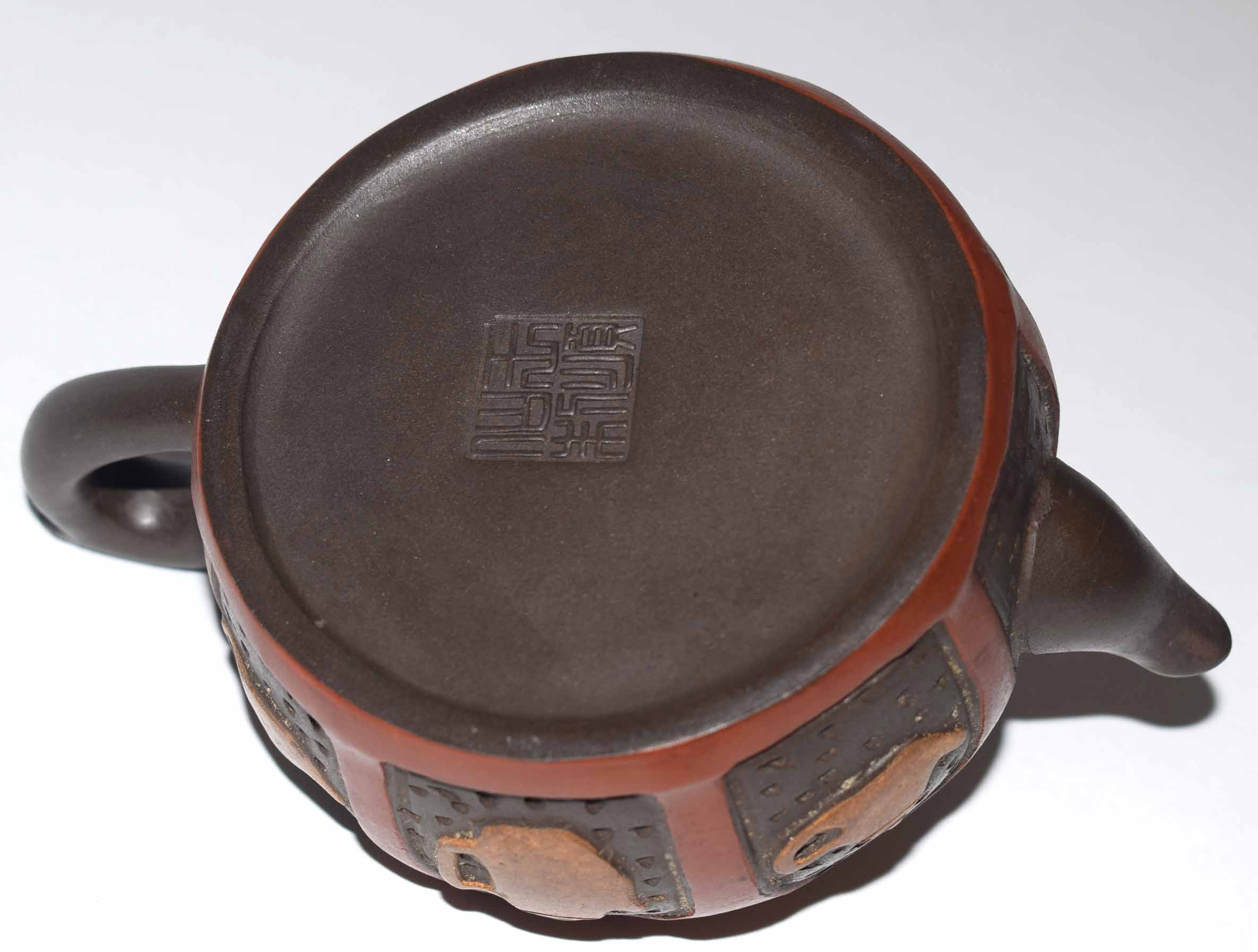 Lot 12 - Chinese red ware teapot and cover, the body decorated with tea and coffee pot motifs, the cover with