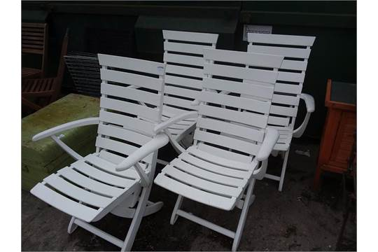 Four Triconfort white plastic garden chairs bought from harrods.
