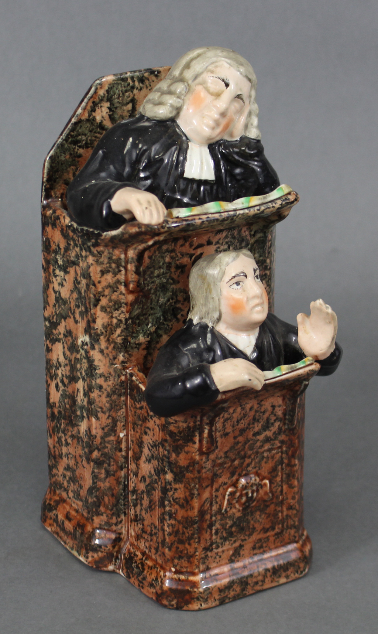 An early 19th century Staffordshire creamware pulpit group of 'The Vicar & Moses', the pulpit with