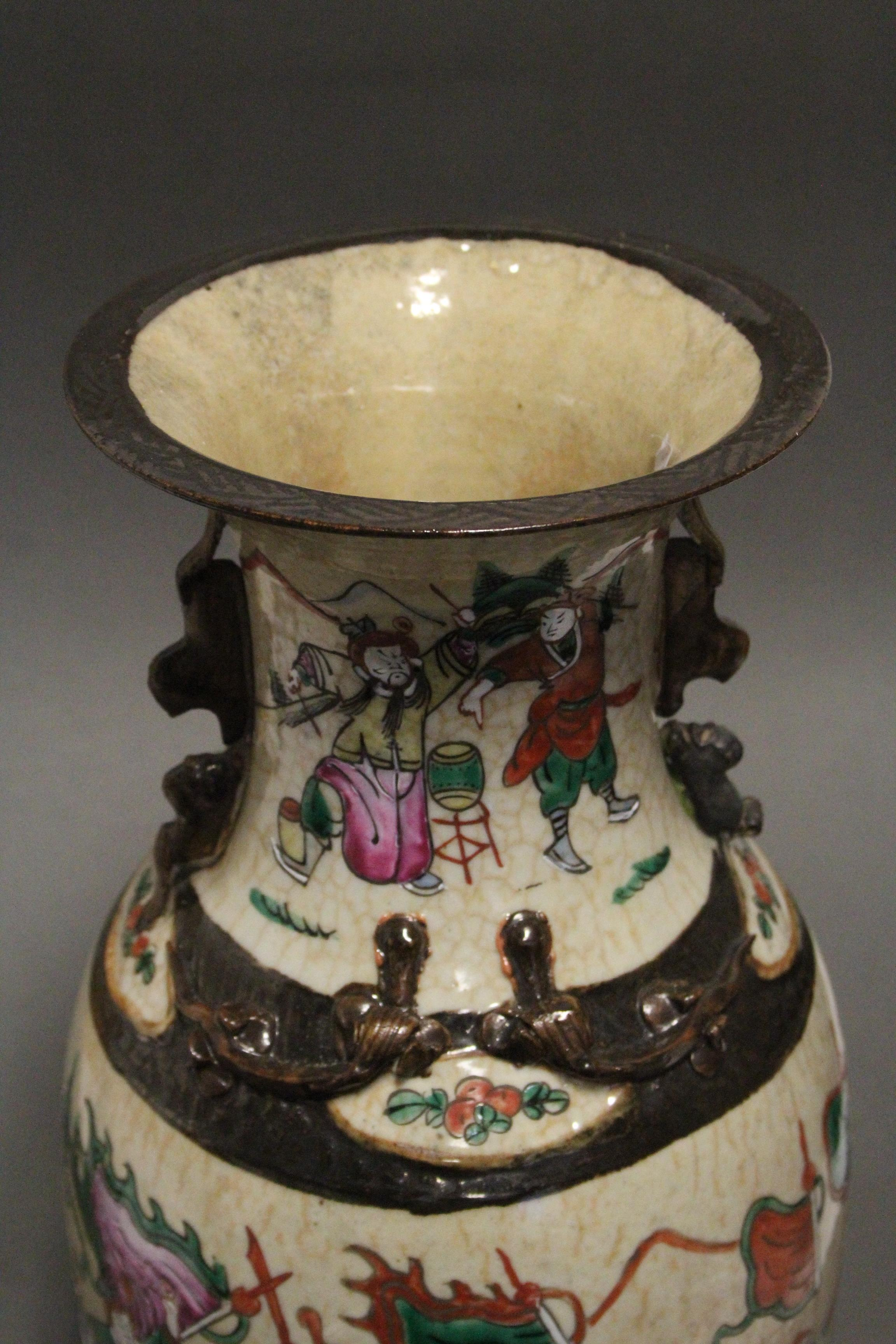 "Lot 193 - A Chinese ""crackleware"" baluster vase with rose-verte enamel decoration of warriors on a cream"