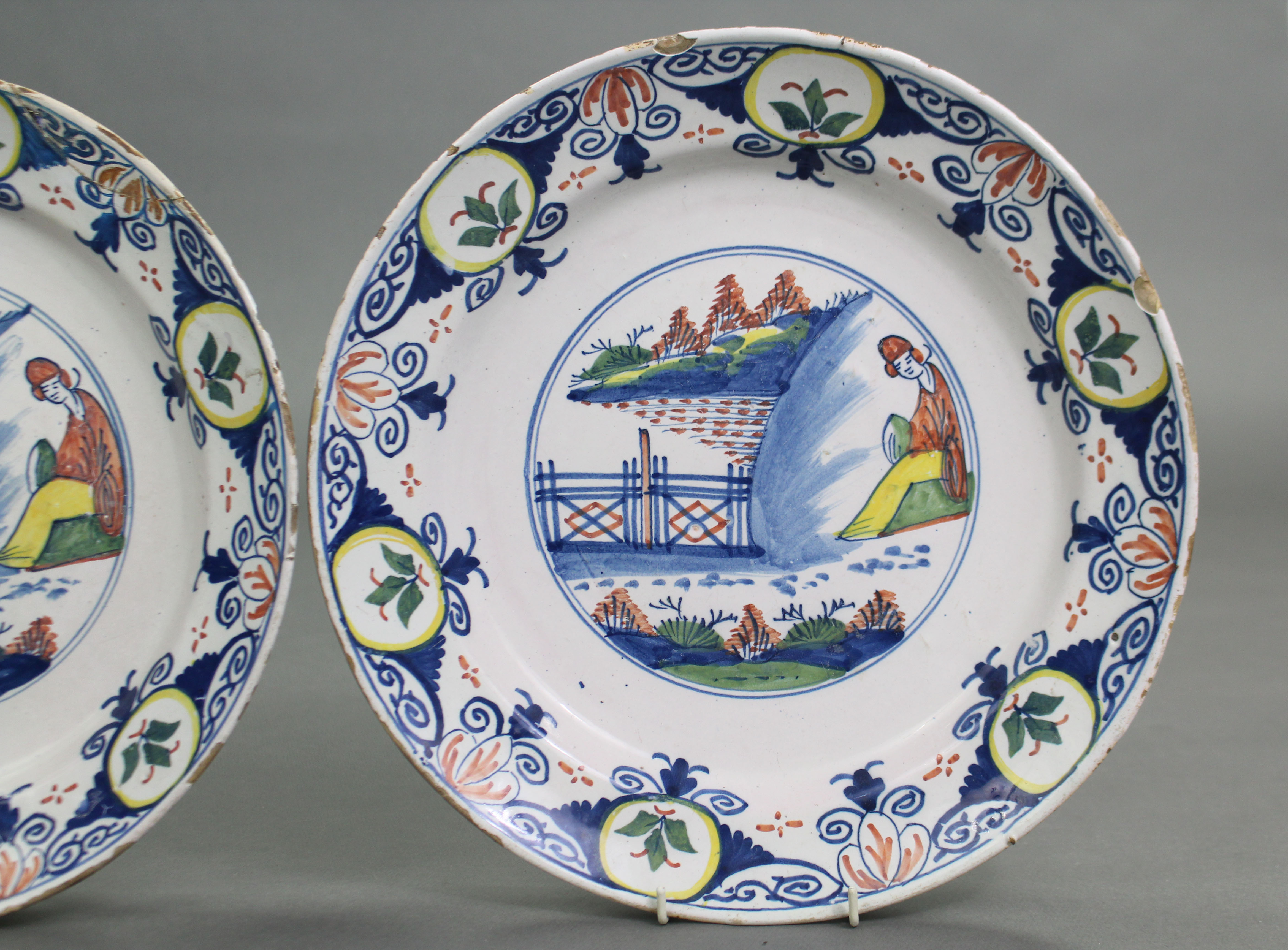 Lot 190 - A PAIR OF 18th century BRISTOL DELFT LARGE DISHES, Limekiln Lane Pottery, circa 1740, each decorated