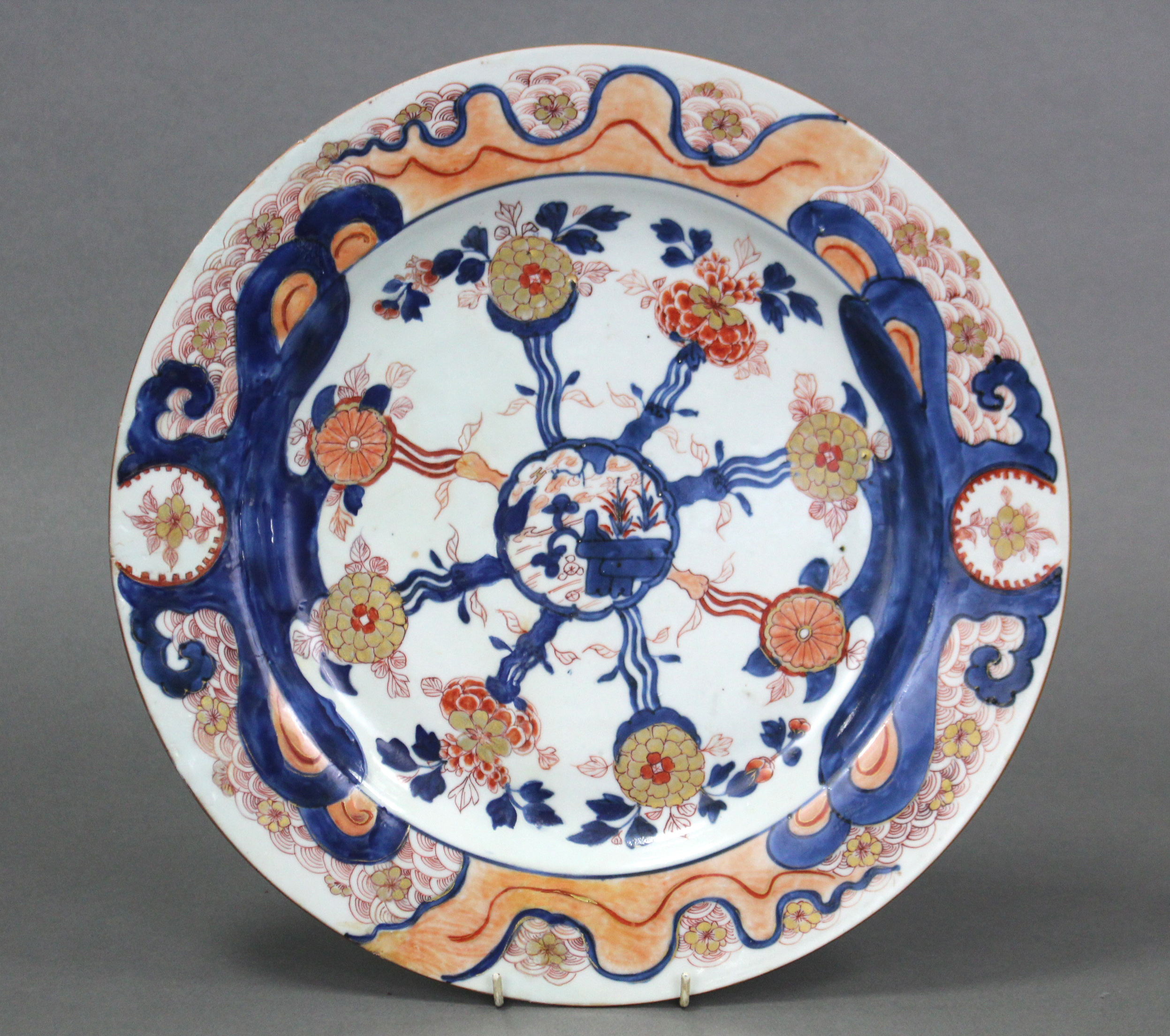 An 18th century Chinese Imari porcelain charger, the centre with landscape decoration & stylised