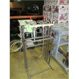 Manual 4 station stainless steel bottle filler ***Auctioneer Note*** -- $25 Removal & Loading Fee