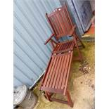 A FOLDING TEAK PATIO LOUNGER.