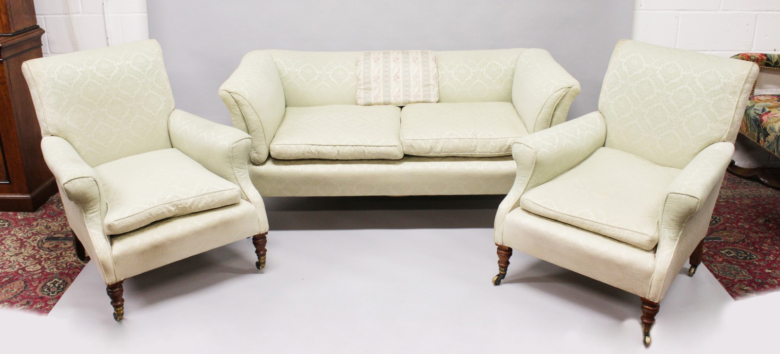 Lot 1030 - HOWARD & SONS, A THREE PIECE UPHOLSTERED SUITE, comprising of a two seater settee and pair of