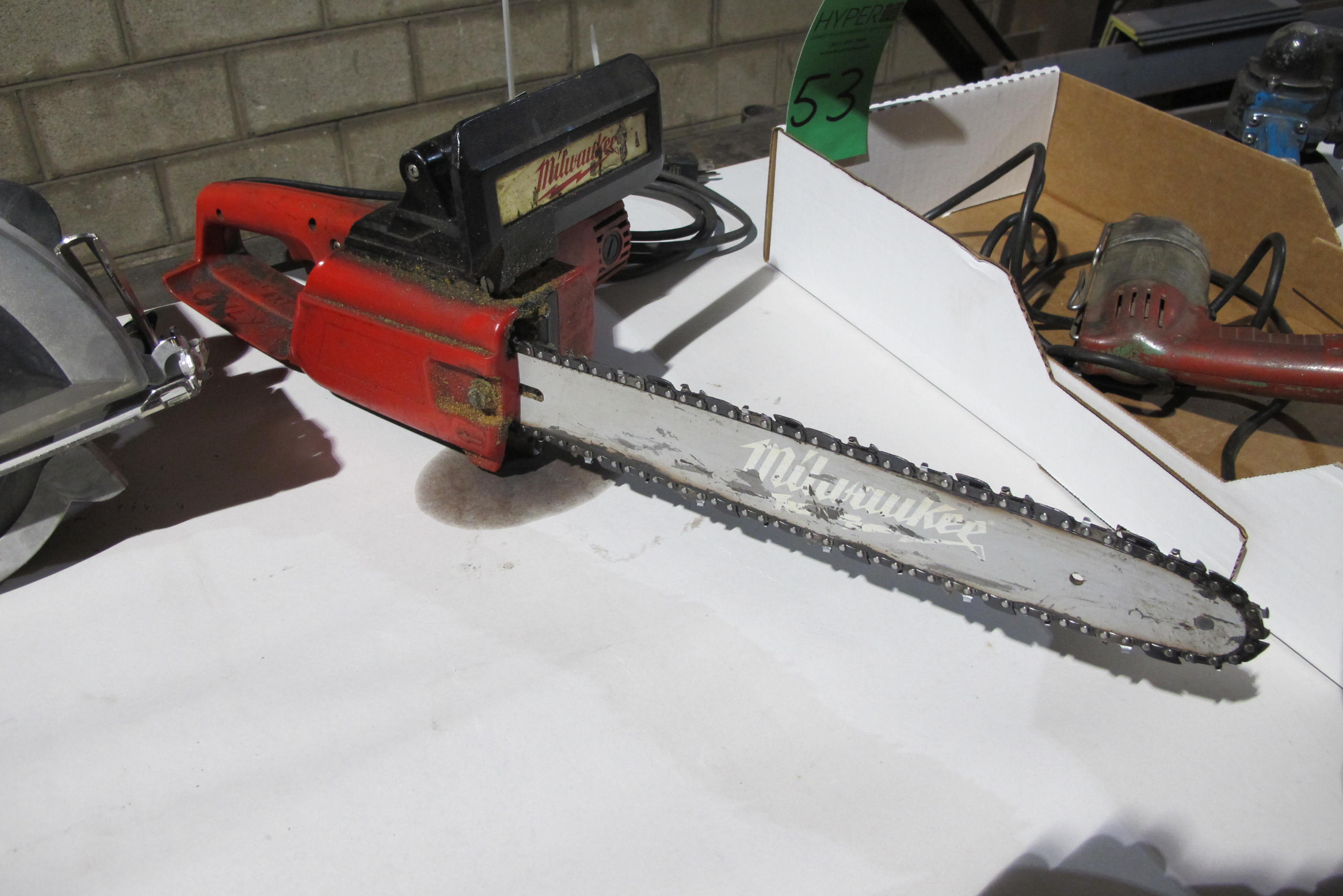Lot 52 - Milwaukee electric chain saw