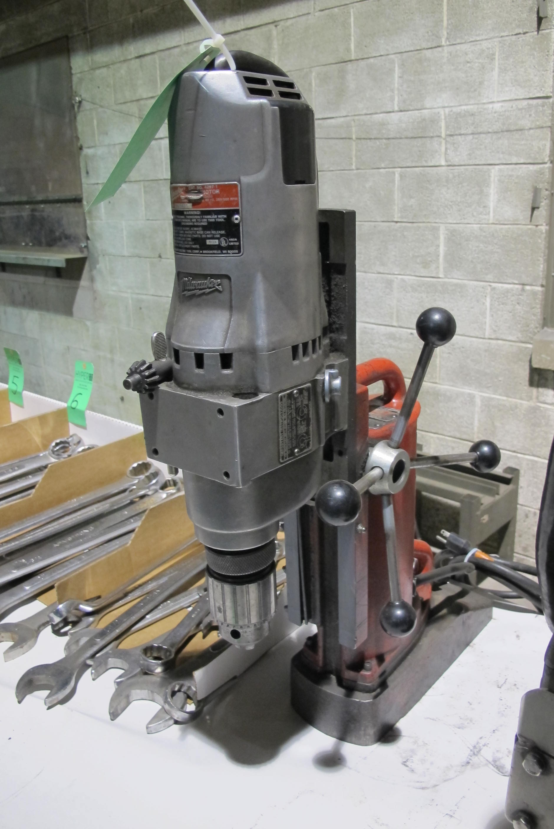 Lot 9 - Milwaukee Cat #4231 electromagnetic drill press W/ Milwaukee Cat #4297-1 drill