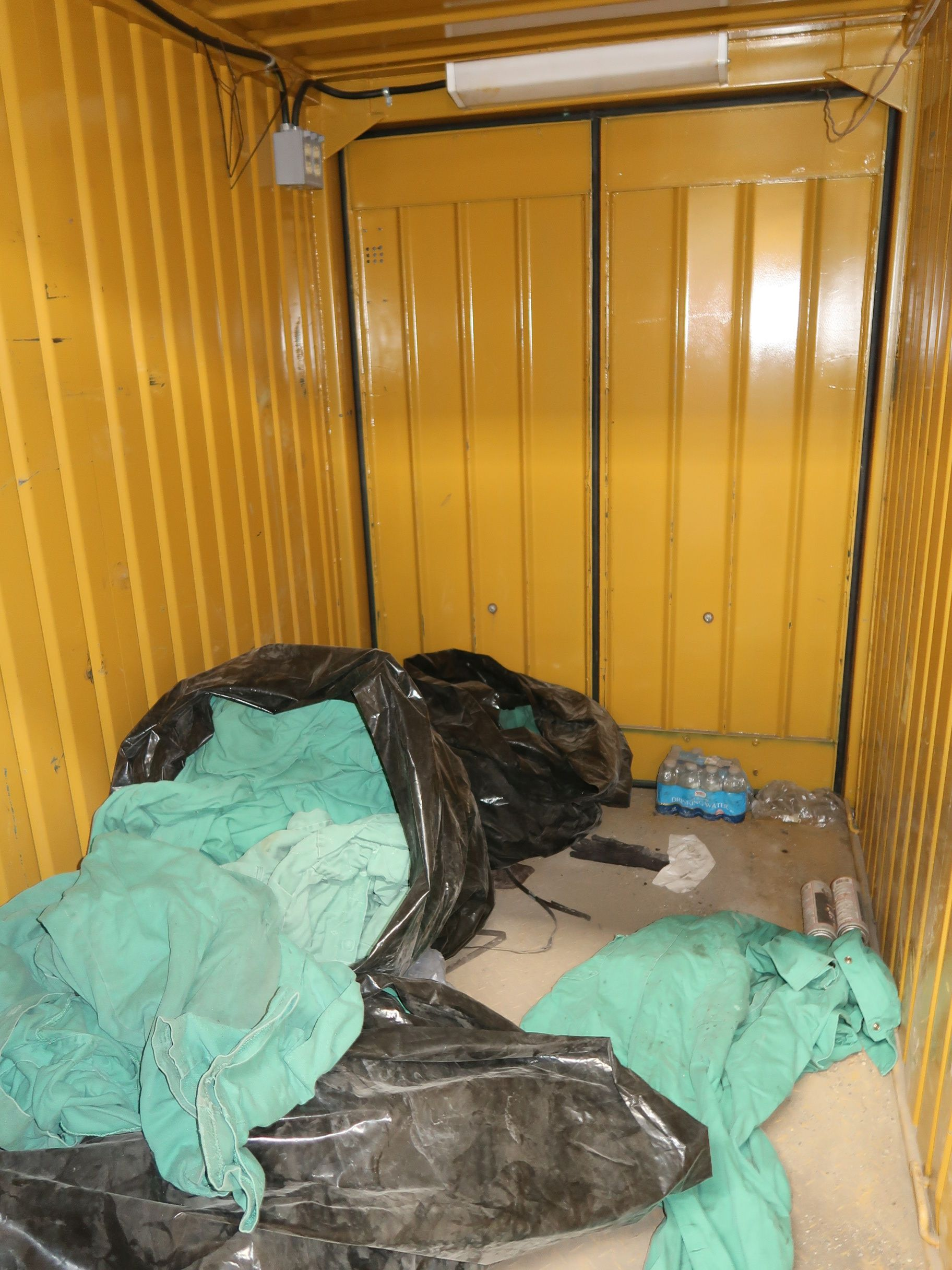 "Lot 200 - 57"" X 96"" X 82"" CONEX STORAGE CONTAINER, DOOR ON EACH END, WITH CONTENTS COVERALLS"