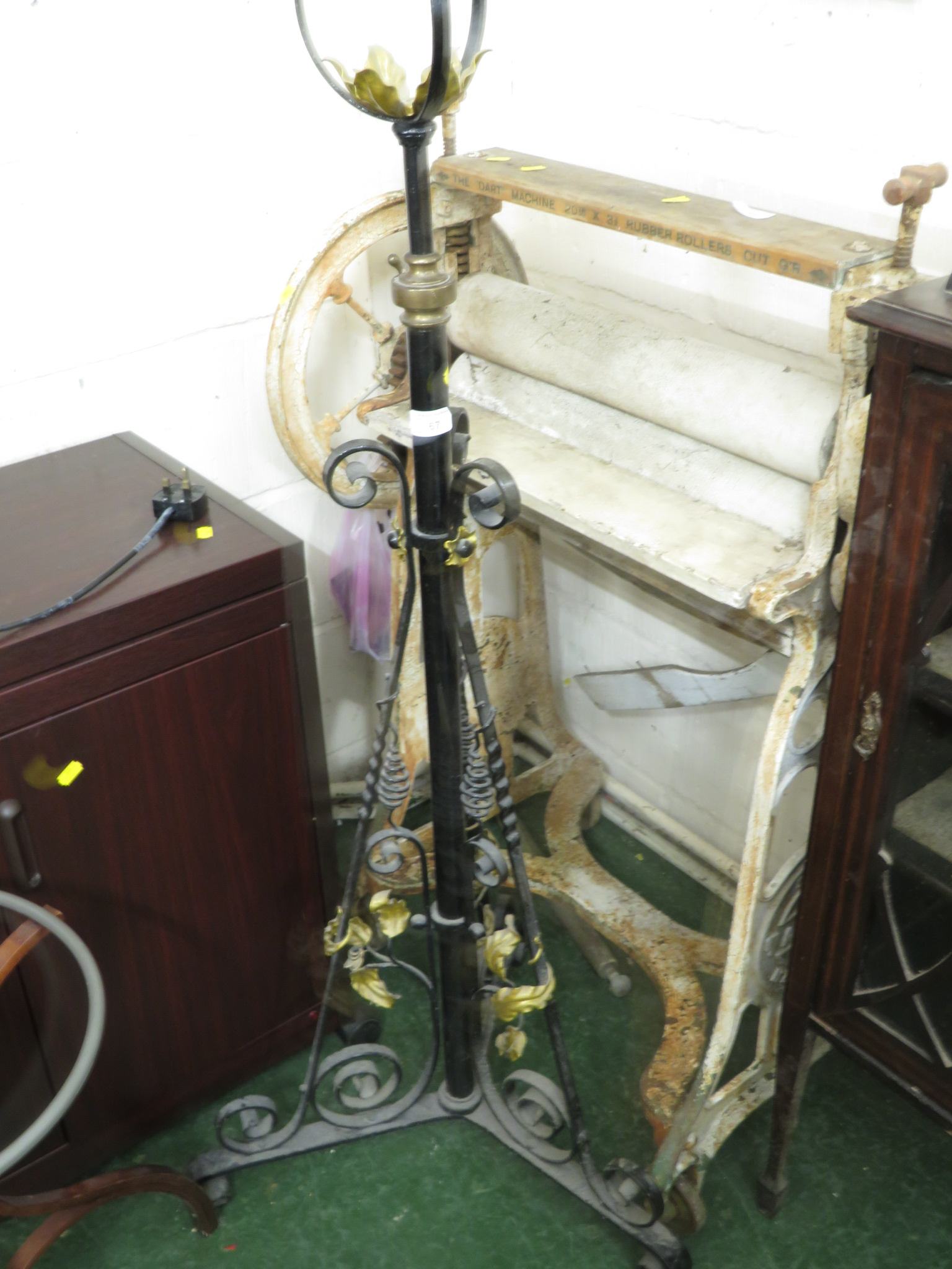 Lot 67 - WROUGHT METAL ADJUSTABLE OIL LAMP STAND PAINTED BLACK WITH BRASS MOUNT AND GILT PAINTED FOLIAGE