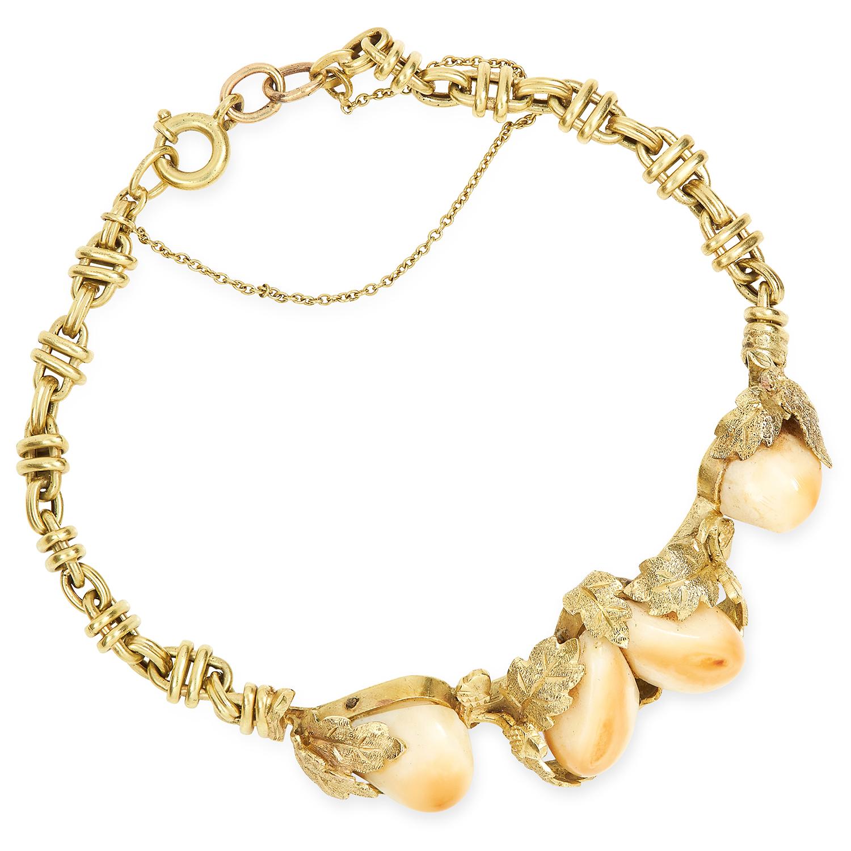 Los 632 - ANTIQUE ELK TEETH BRACELET set with four elk teeth in foliate gold border, 9.9g.