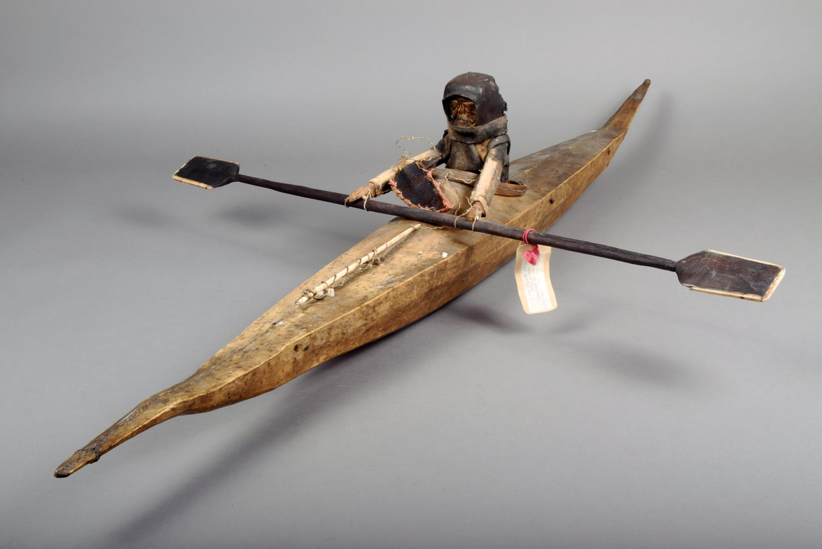 An Inuit Model Kayak Seal Skin On A Wooden Frame With A
