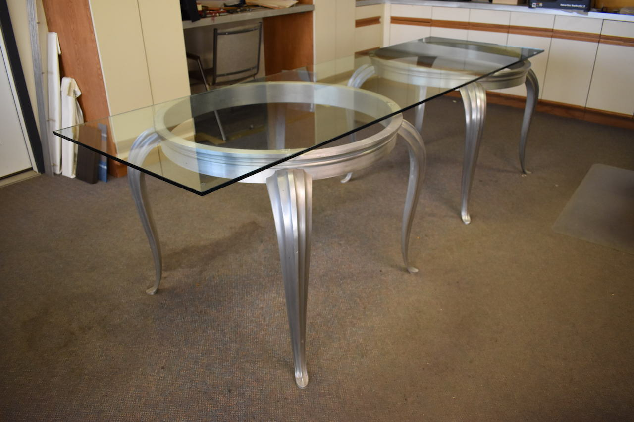 Lot 610 - 31 in. x 104 in. Glass Top Double Pedestal Table