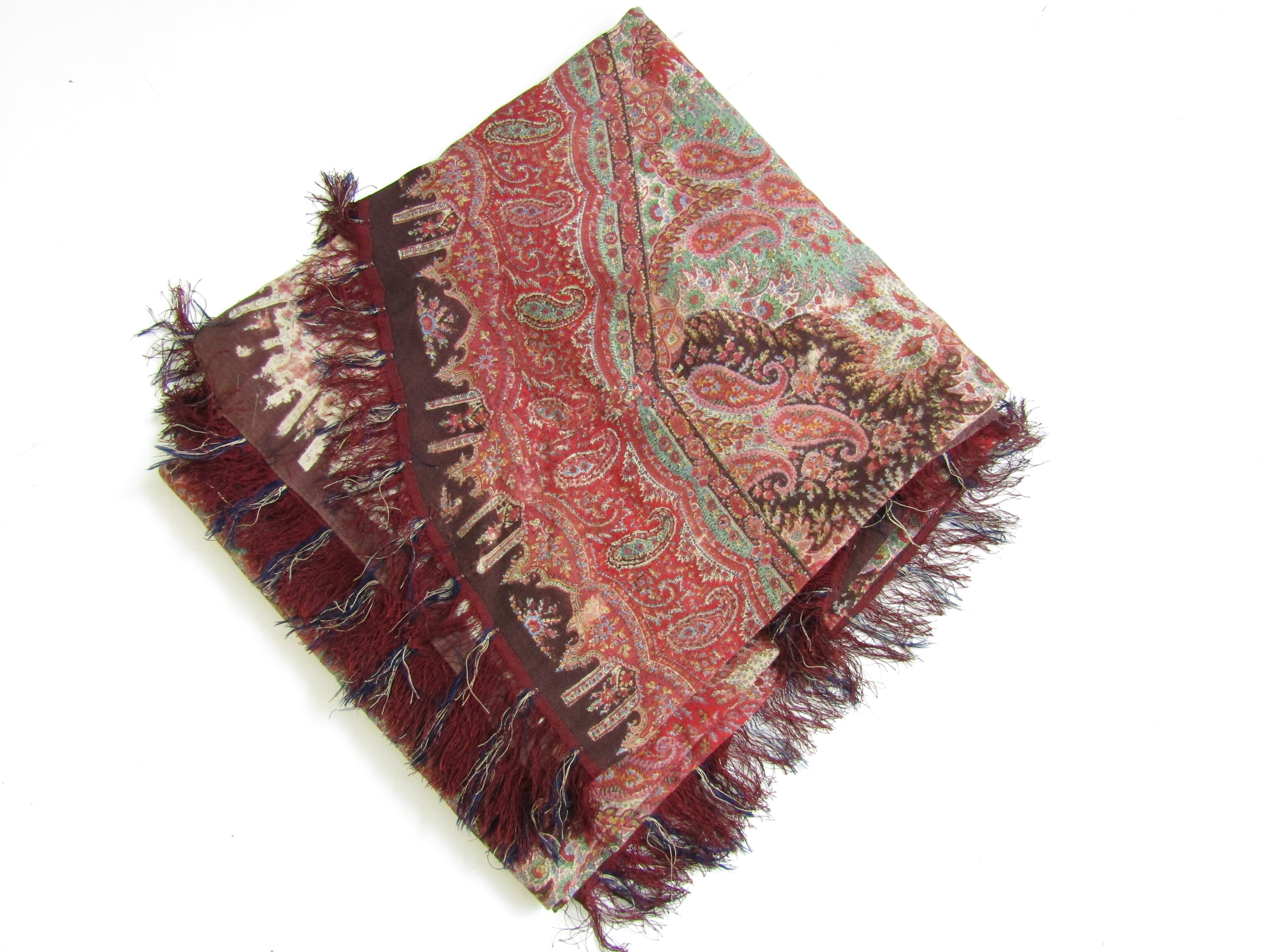 Lot 43 - A 19th Century printed paisley shawl, with curved and tasselled lower edge, 330 x 180 cm